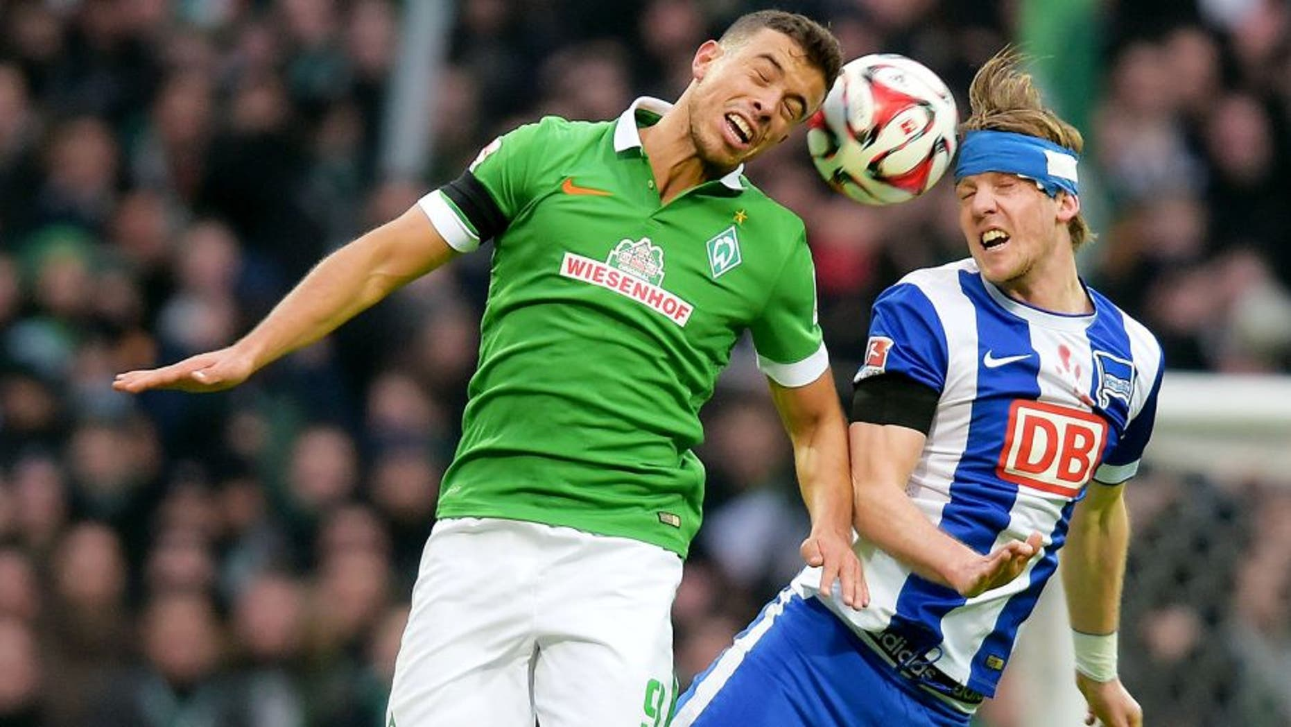 BREMEN, GERMANY - FEBRUARY 01: Franco Di Santo of Werder Bremen and Peter Niemeyer of Hertha BSC go up for a header during the game between Werder Bremen and Hertha BSC on february 1, 2015 in Bremen, Germany. (Photo by Marco Leipold/City-Press via Getty Images)