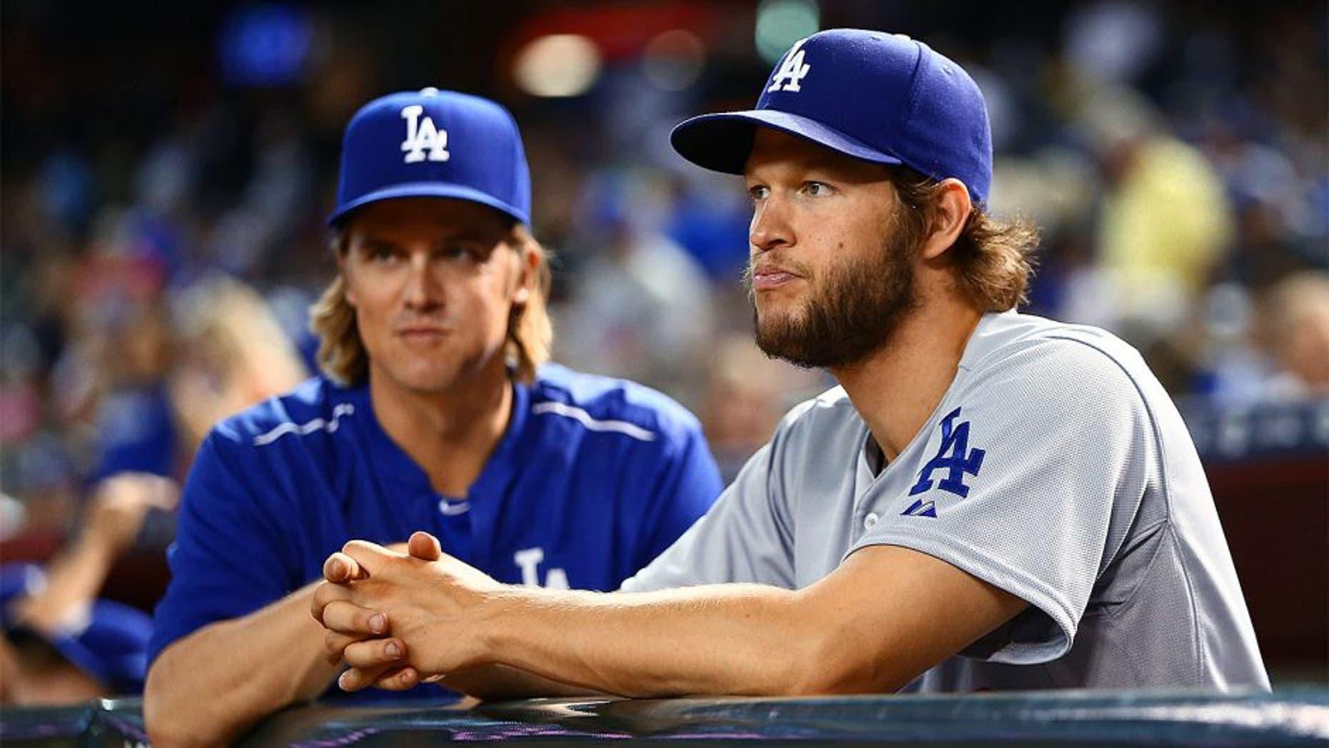 Jun 29, 2015; Phoenix, AZ, USA; Los Angeles Dodgers pitcher Clayton Kershaw (right) and Zack Greinke in the first inning against the Arizona Diamondbacks at Chase Field. Mandatory Credit: Mark J. Rebilas-USA TODAY Sports
