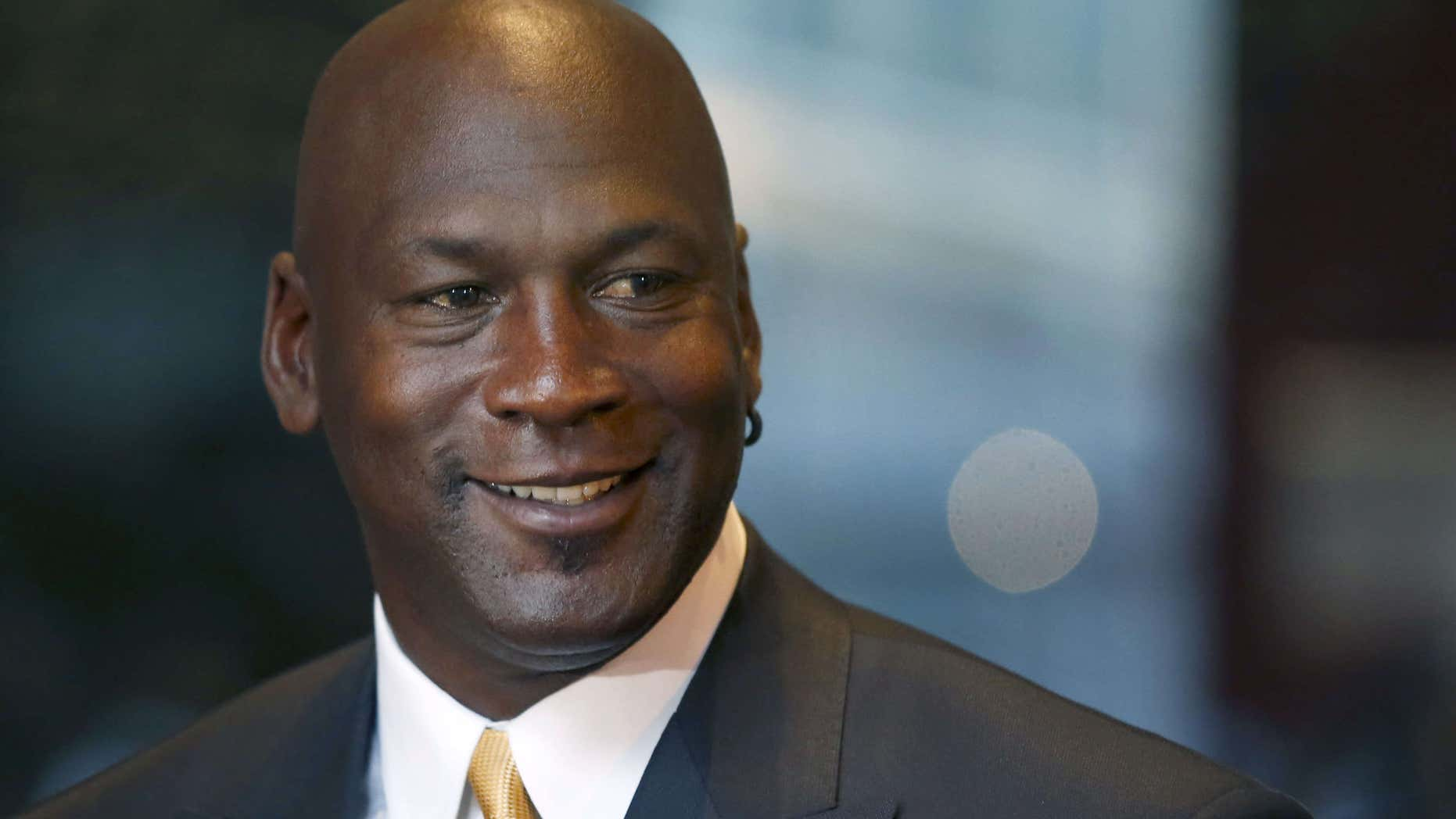 Aug. 21, 2015: Michael Jordan smiles at reporters after a jury ordered a defunct grocery store chain to pay him $8.9 million for using his name without permission.