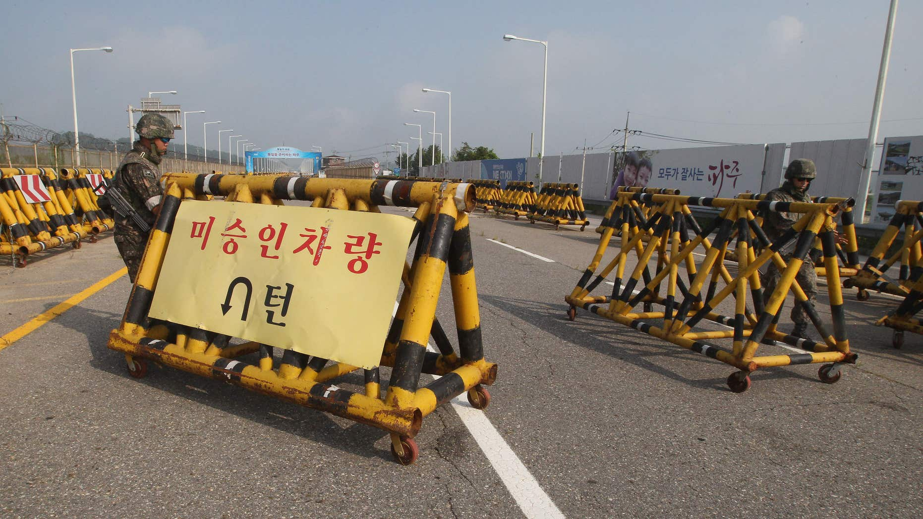 Aug. 22, 2015: South Korean army soldiers adjust barricades set up on Unification Bridge, which leads to the demilitarized zone, near the border village of Panmunjom in Paju, South Korea.