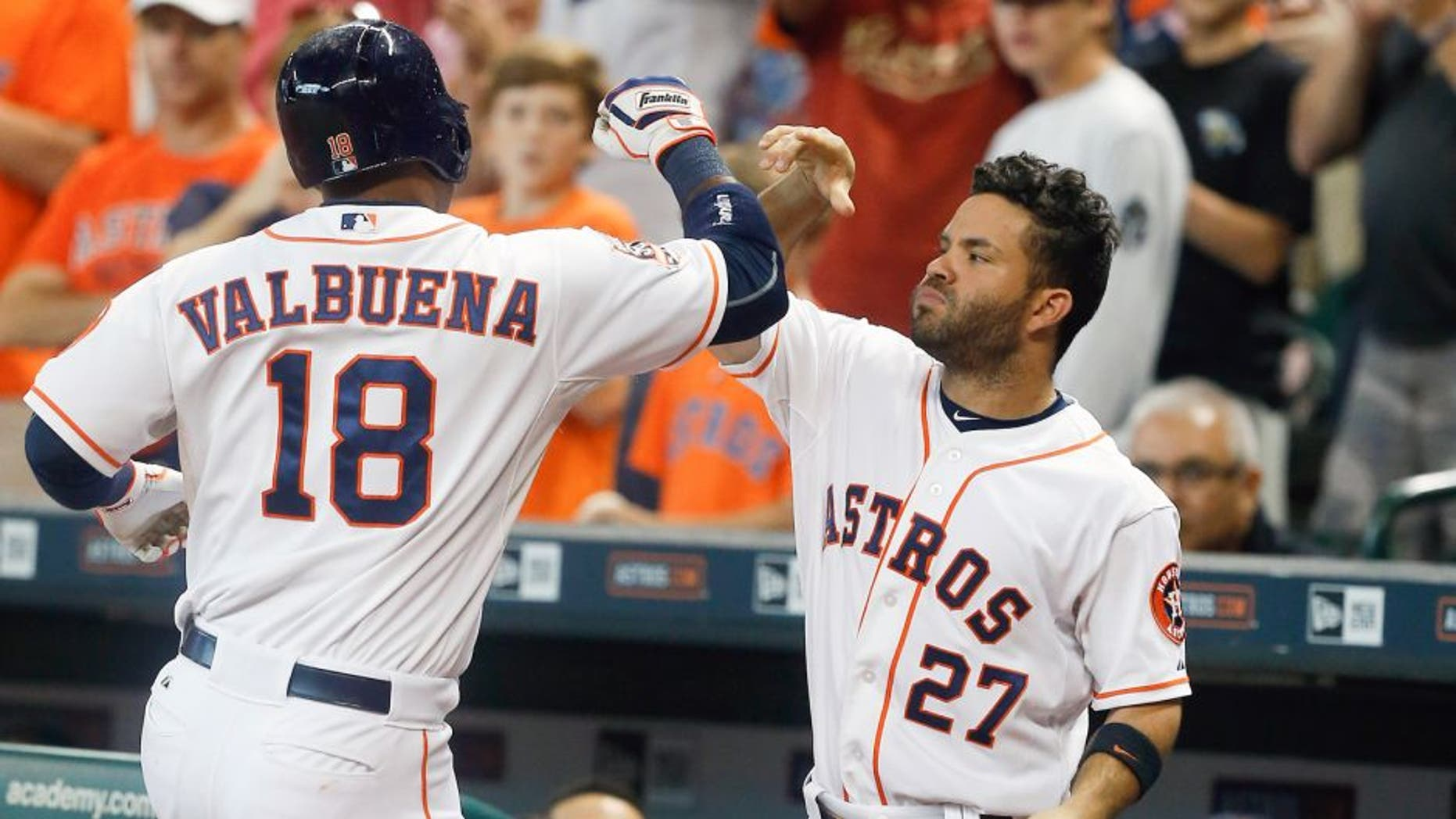 HOUSTON, TX - AUGUST 22: Luis Valbuena #18 of the Houston Astros celebrates with Jose Altuve #27 afer hitting a home run in the second inning against the Los Angeles Dodgers at Minute Maid Park on August 22, 2015 in Houston, Texas. (Photo by Bob Levey/Getty Images)
