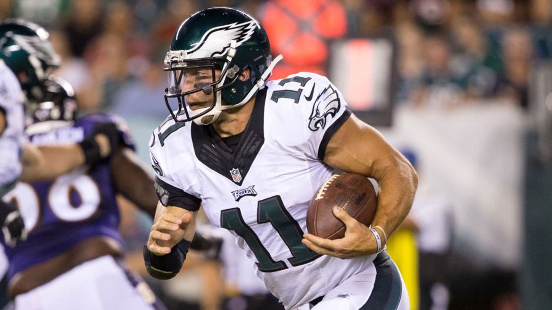 Aug 22, 2015; Philadelphia, PA, USA; Philadelphia Eagles quarterback Tim Tebow (11) runs with the ball against the Baltimore Ravens during the fourth quarter at Lincoln Financial Field. The Eagles won 40-17. Mandatory Credit: Bill Streicher-USA TODAY Sports