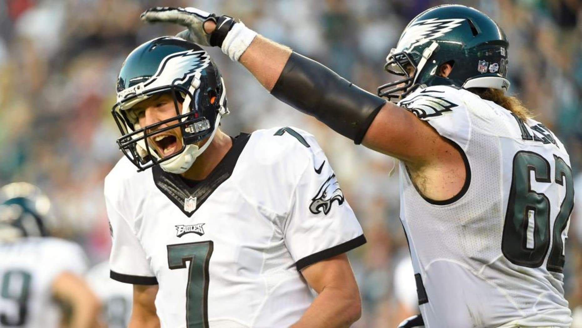 Aug 22, 2015; Philadelphia, PA, USA; Philadelphia Eagles quarterback Sam Bradford (7) celebrates a touchdown with center Jason Kelce (62) against the Baltimore Ravens during the first quarter at Lincoln Financial Field. Mandatory Credit: Eric Hartline-USA TODAY Sports