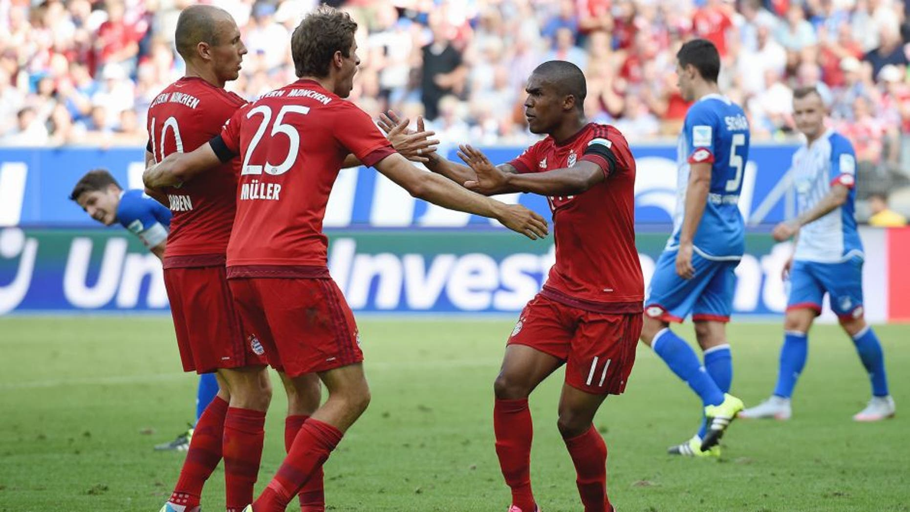 SINSHEIM, GERMANY - AUGUST 22: Thomas Mueller of Muenchen celebrates with his team-mates after scoring his team's first goal during the Bundesliga match between 1899 Hoffenheim and FC Bayern Muenchen at Wirsol Rhein-Neckar-Arena on August 22, 2015 in Sinsheim, Germany. (Photo by Matthias Hangst/Bongarts/Getty Images)