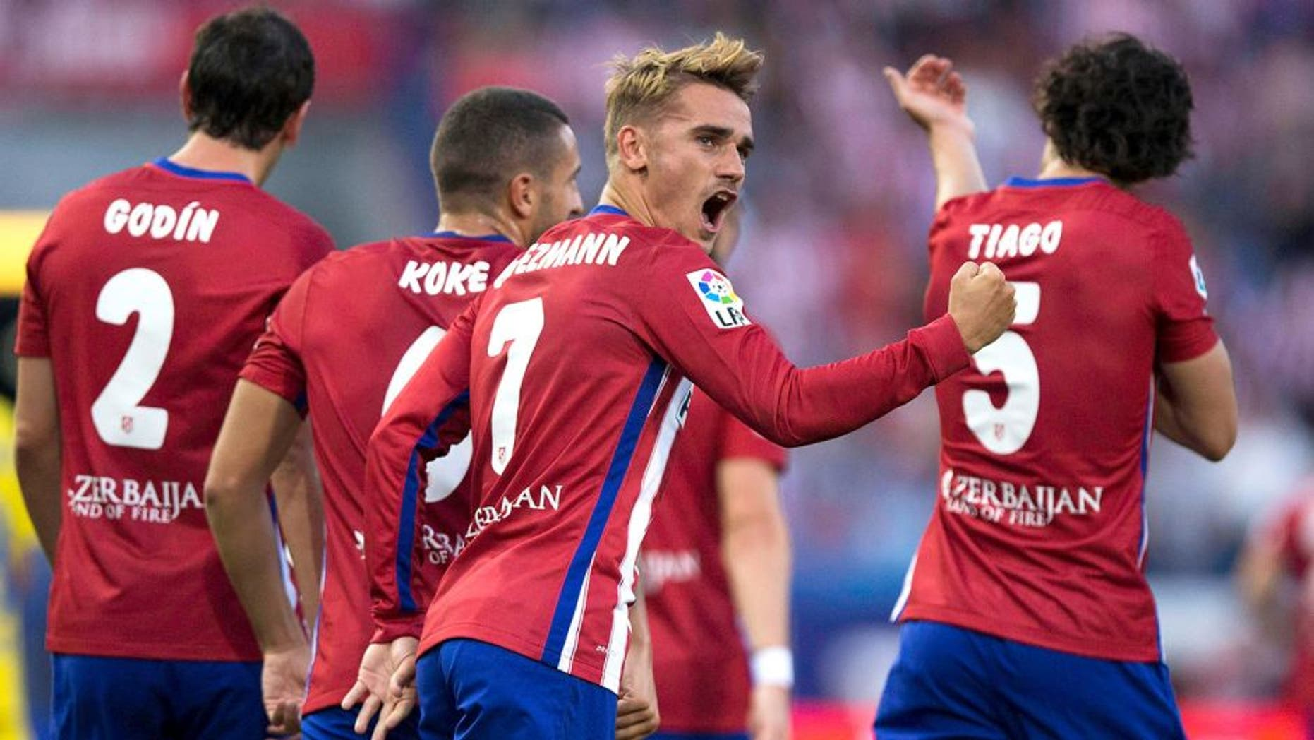 MADRID, SPAIN - AUGUST 22: Antoine Griezmann of Atletico de Madrid celebrates scoring their opening goal during the La Liga match between Club Atletico de Madrid and UD Las Palmas at Vicente Calderon Stadium on August 22, 2015 in Madrid, Spain. (Photo by Gonzalo Arroyo Moreno/Getty Images)