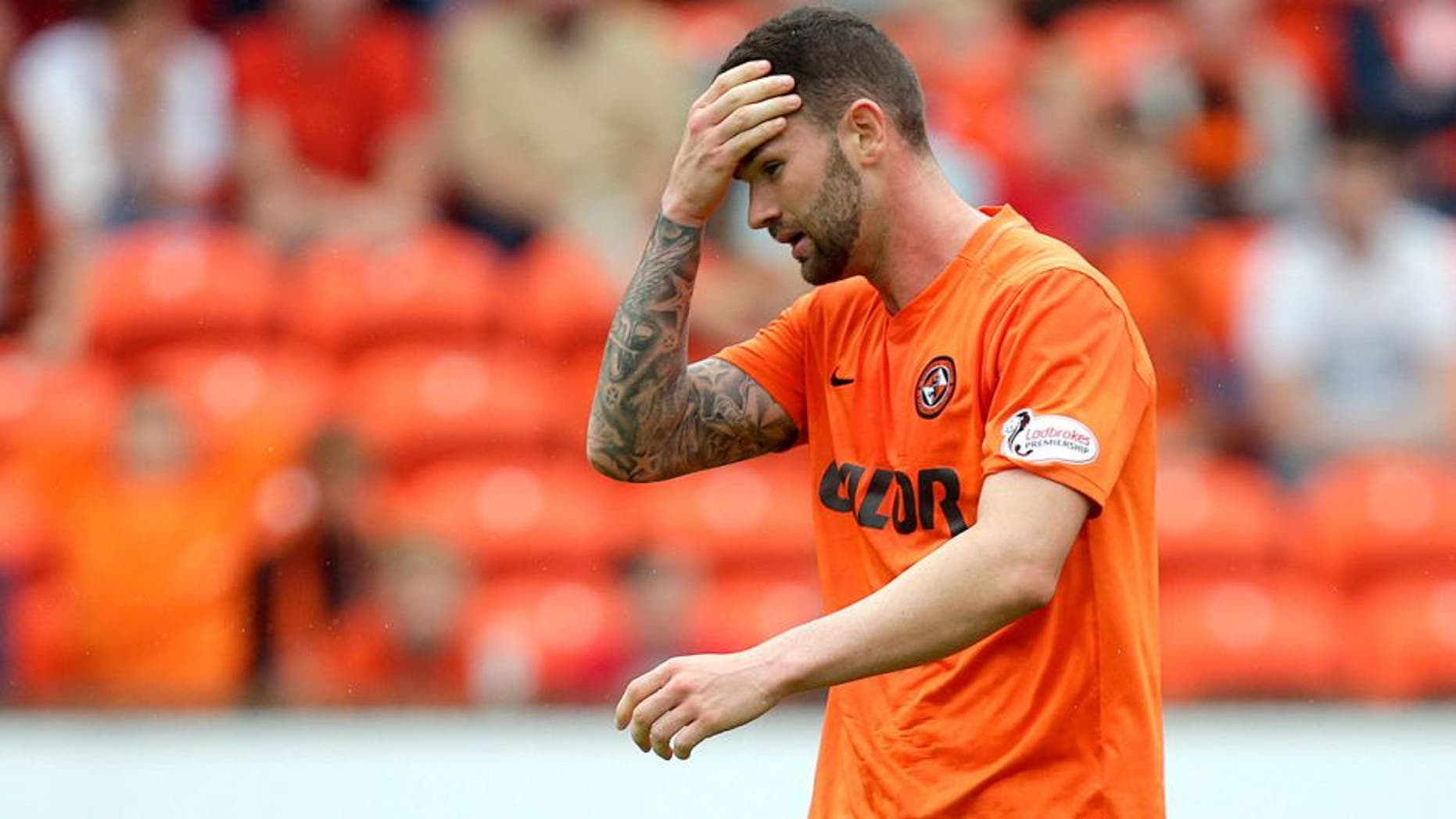"""Football - Dundee United v Celtic - Ladbrokes Scottish Premiership - Tannadice Park - 22/8/15 Dundee United's Mark Durnan looks dejected after scoring an own goal for Celtic Action Images via Reuters / Graham Stuart Livepic EDITORIAL USE ONLY. No use with unauthorized audio, video, data, fixture lists, club/league logos or """"live"""" services. Online in-match use limited to 45 images, no video emulation. No use in betting, games or single club/league/player publications. Please contact your account representative for further details."""