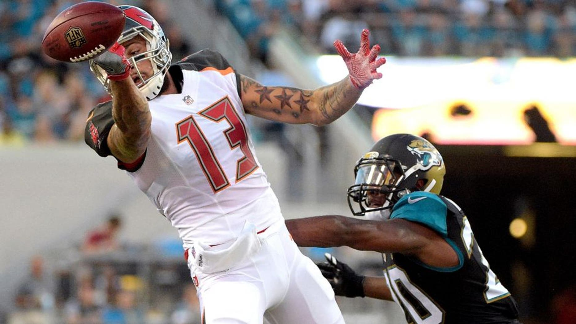 Tampa Bay Buccaneers wide receiver Mike Evans (13) cannot make a reception while defended by Jacksonville Jaguars cornerback Jalen Ramsey (20) during the first half of an NFL preseason football game in Jacksonville, Fla., Saturday, Aug. 20, 2016. (AP Photo/Phelan M. Ebenhack)