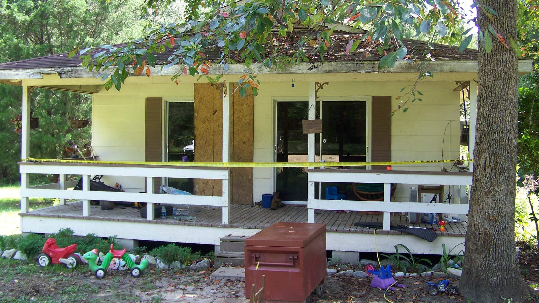 Crime scene tape marks the home on Jim Platt Road near Citronelle, Ala., Sunday, Aug. 21, 2016, where authorities said five people were killed on Saturday.