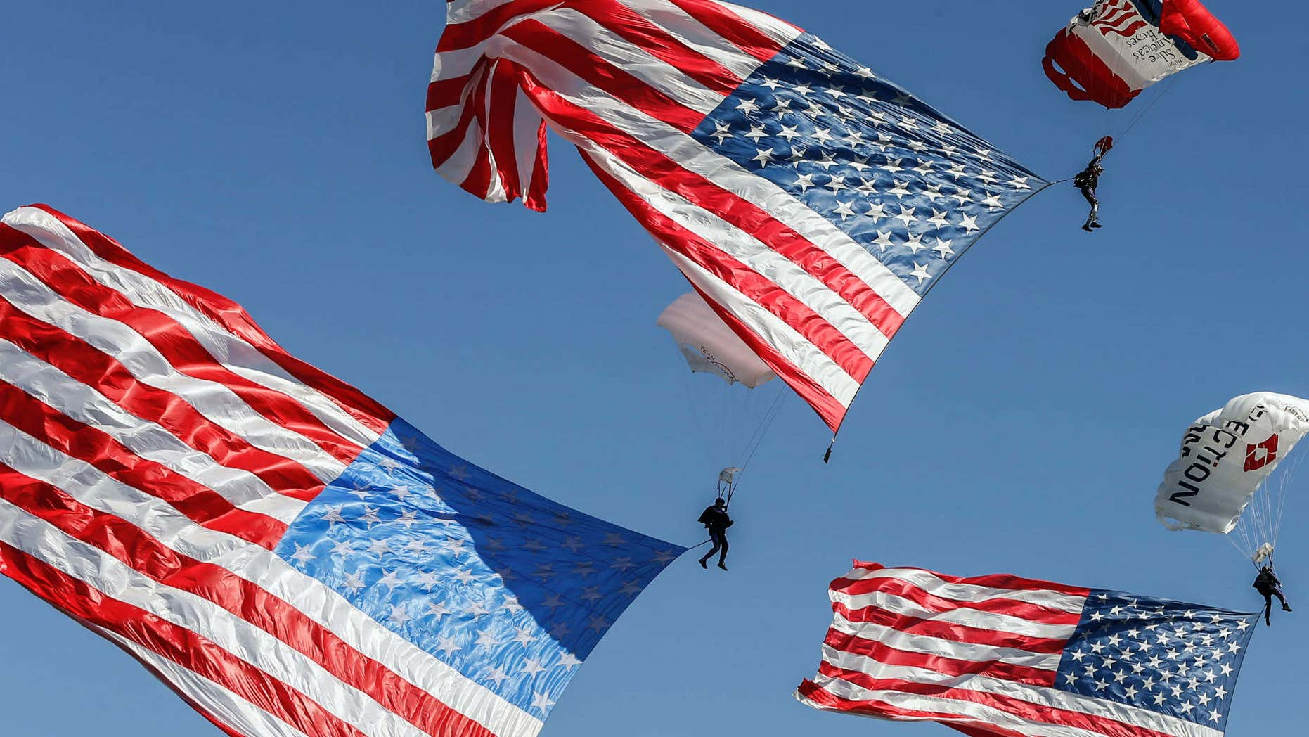 Aug. 21, 2015: Parachuters fly over Lakota West's football field during the funeral service in West Chester, Ohio, for Army Master Sgt. Corey Hood.