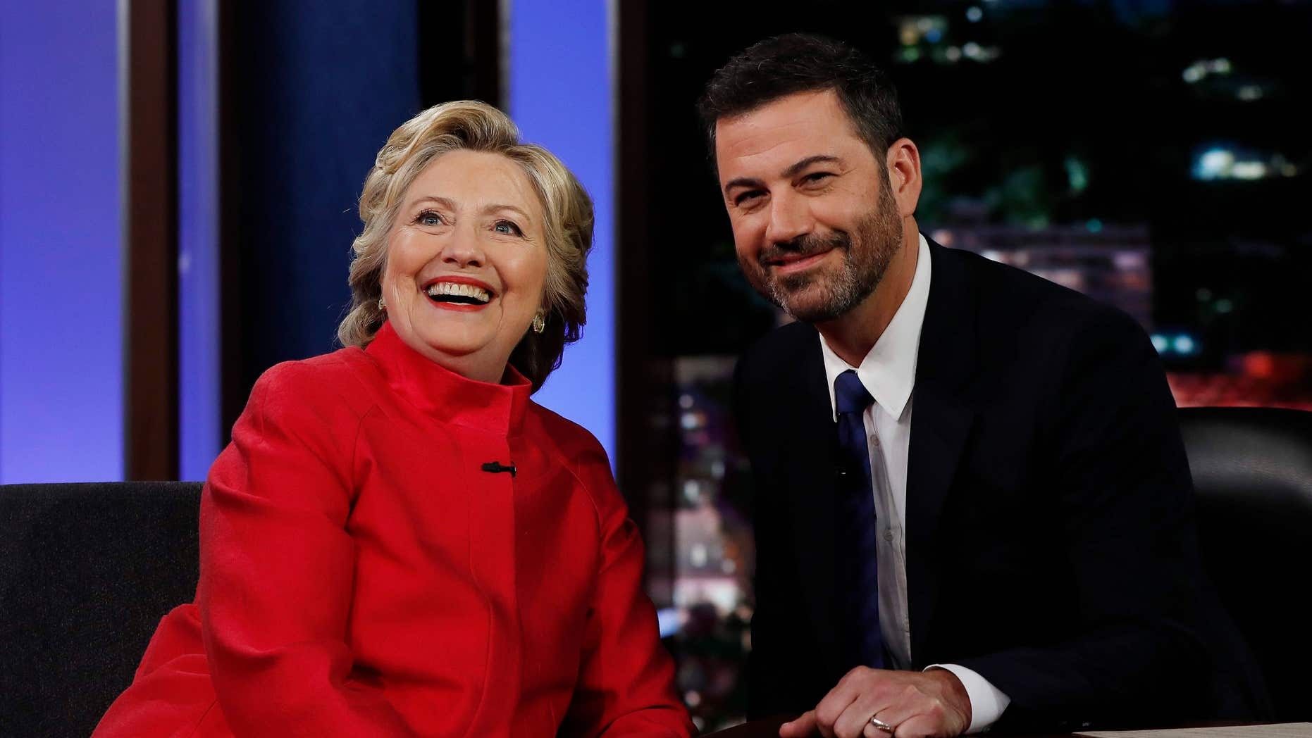 "Aug. 22, 2016: Democratic presidential nominee Hillary Clinton pauses to pose for a photograph as she talks with Jimmy Kimmel during a break in taping of ""Jimmy Kimmel Live!"" in Los Angeles."