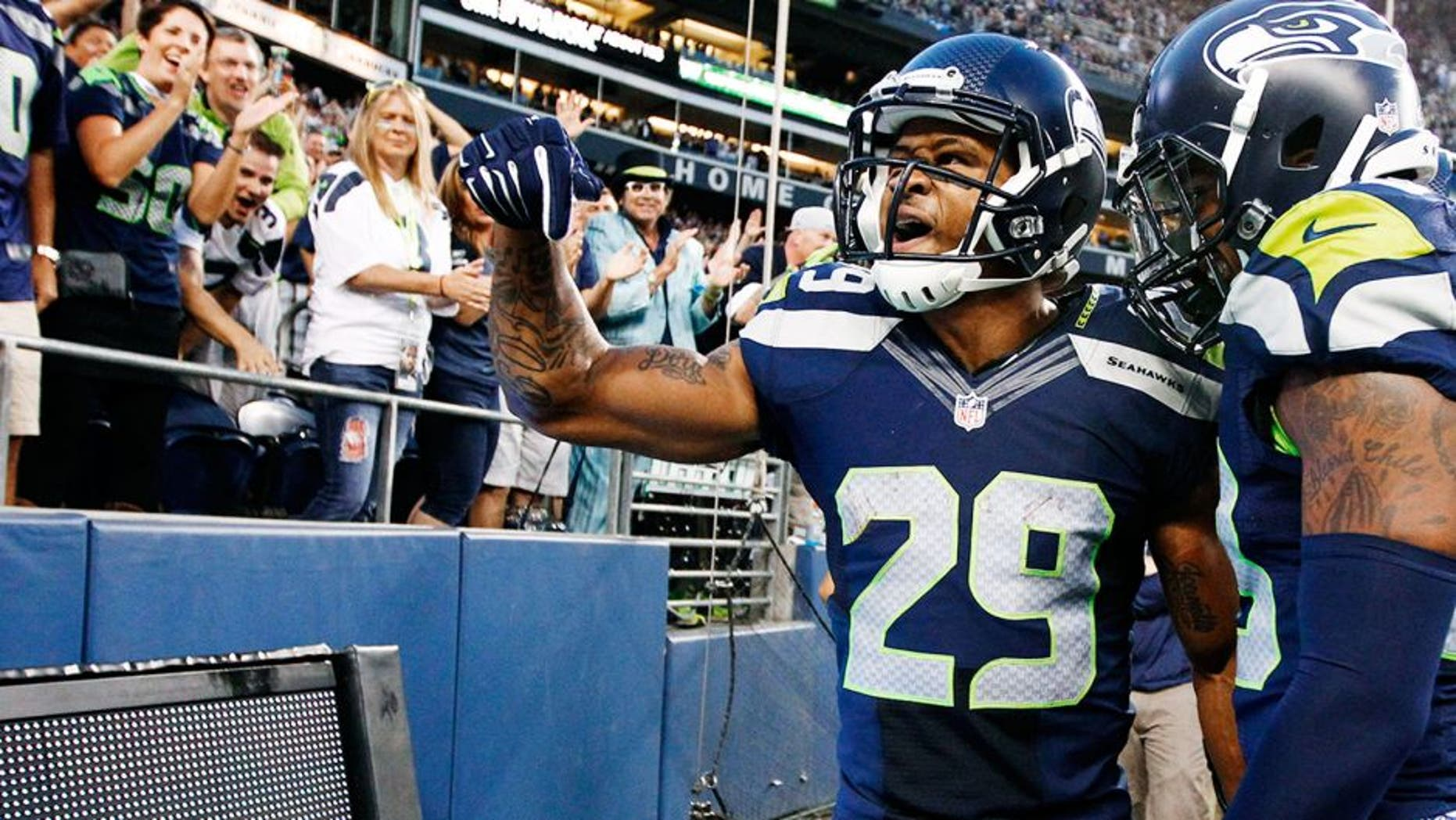 Aug 22, 2014; Seattle, WA, USA; Seattle Seahawks free safety Earl Thomas (29) celebrates after a 59-yard punt return against the Chicago Bears during the second quarter at CenturyLink Field. Seattle Seahawks strong safety Jeron Johnson (23) is at right. Mandatory Credit: Joe Nicholson-USA TODAY Sports