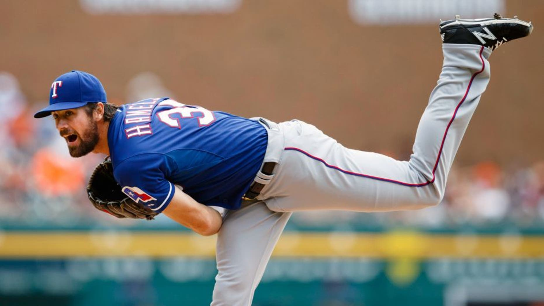 Aug 23, 2015; Detroit, MI, USA; Texas Rangers starting pitcher Cole Hamels (35) pitches in the first inning against the Detroit Tigers at Comerica Park. Mandatory Credit: Rick Osentoski-USA TODAY Sports
