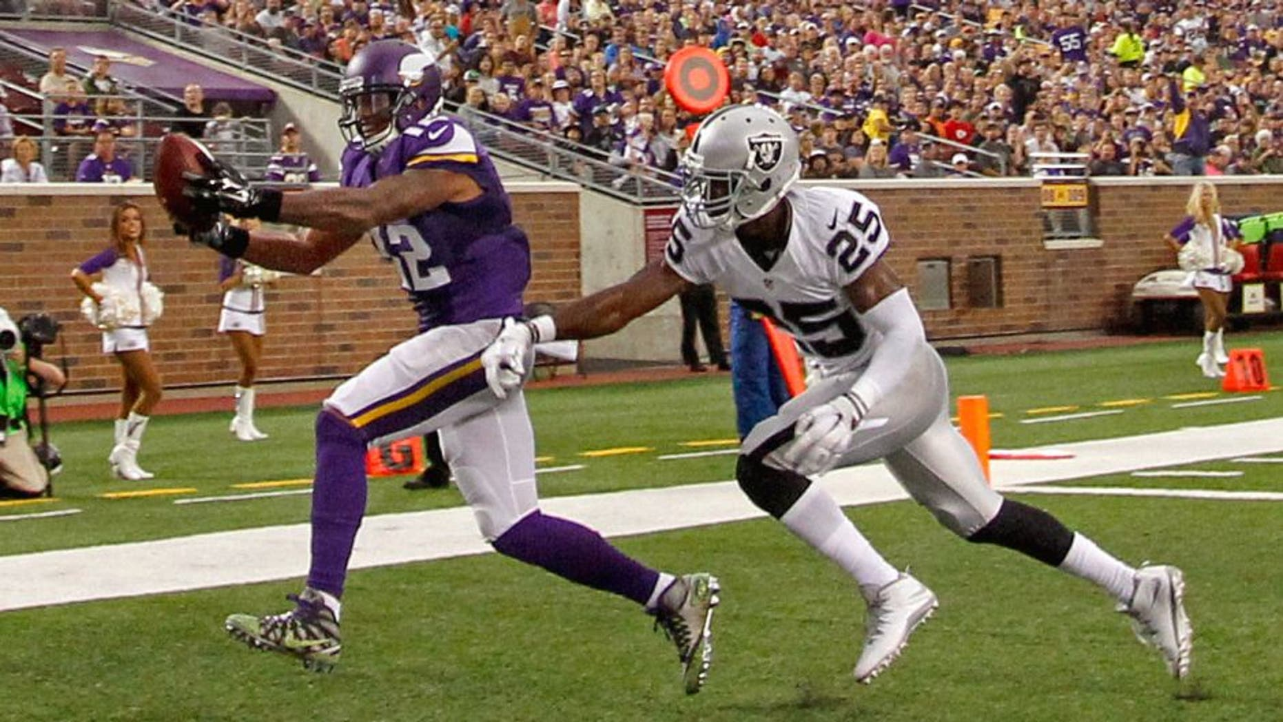 Aug 22, 2015; Minneapolis, MN, USA; Minnesota Vikings wide receiver Charles Johnson (12) catches a pass past Oakland Raiders cornerback D.J. Hayden (25) for a touchdown in the second quarter at TCF Bank Stadium. Mandatory Credit: Bruce Kluckhohn-USA TODAY Sports