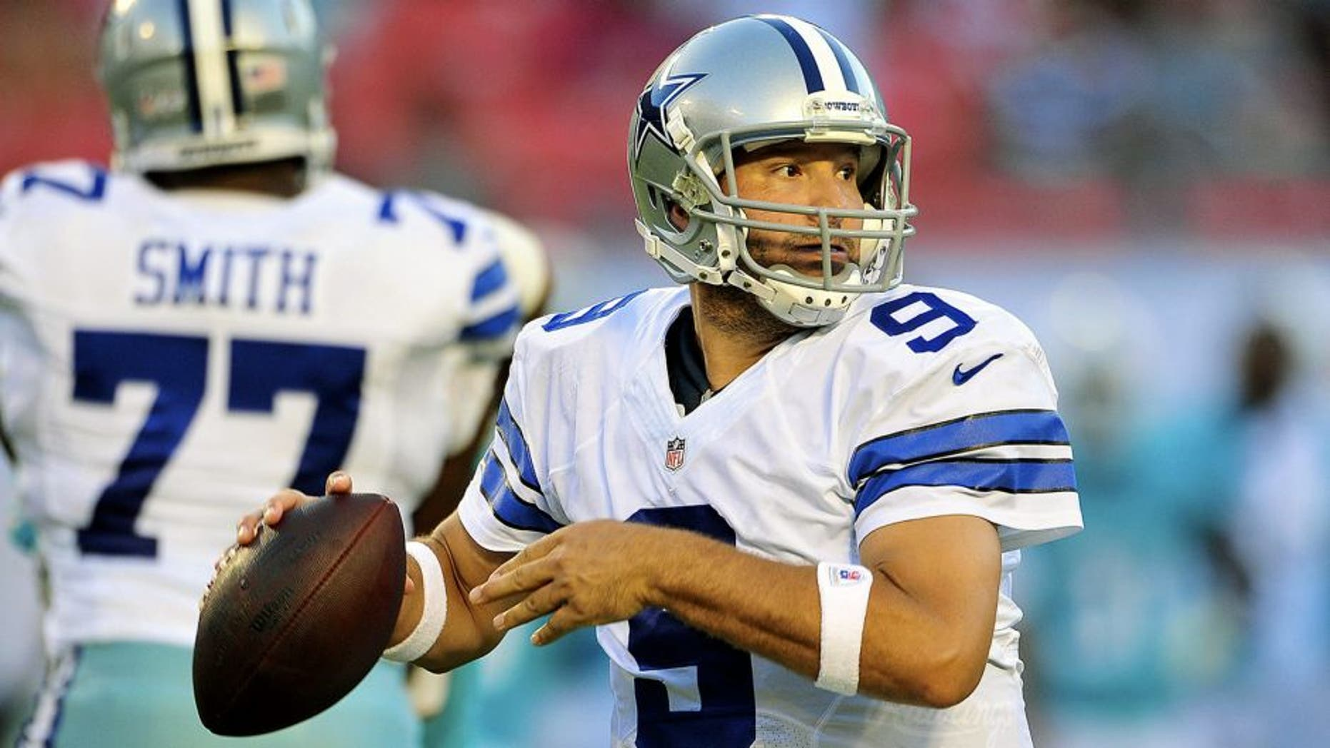 MIAMI GARDENS, FL - AUGUST 23: Quarterback Tony Romo #9 of the Dallas Cowboys looks for a receiver during a preseason game against the Miami Dolphins at Sun Life Stadium on August 23, 2014 in Miami Gardens, Florida. (Photo by Ronald C. Modra/Sports Imagery/ Getty Images)