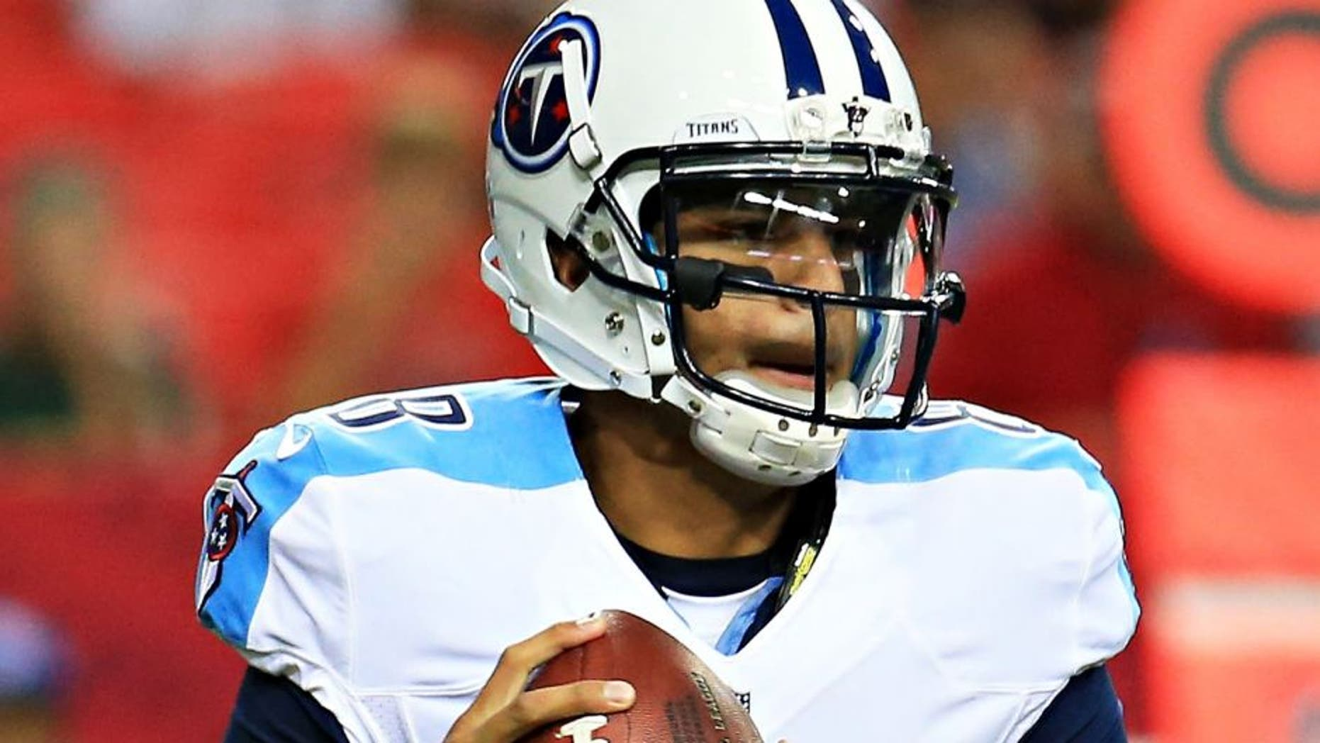 ATLANTA, GA - AUGUST 14: Marcus Mariota #8 of the Tennessee Titans rolls out on a pass play in the first half of a preseason game against the Atlanta Falcons at the Georgia Dome on August 14, 2015 in Atlanta, Georgia. (Photo by Daniel Shirey/Getty Images)