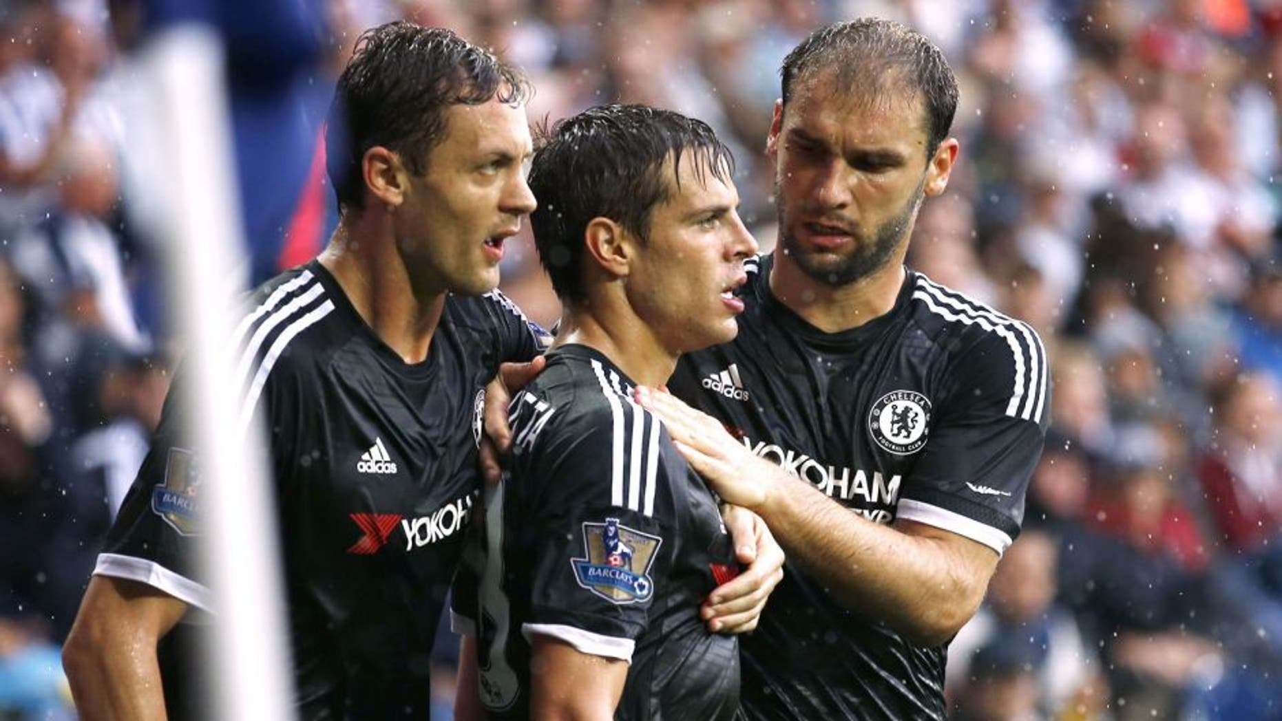 Chelsea's Spanish defender Cesar Azpilicueta (2nd R) celebrates with Chelsea's Serbian midfielder Nemanja Matic and Chelsea's Serbian defender Branislav Ivanovic (R) after scoring their third goal during the English Premier League football match between West Bromwich Albion and Chelsea at The Hawthorns in West Bromwich, central England on August 23, 2015. AFP PHOTO / JUSTIN TALLIS RESTRICTED TO EDITORIAL USE. No use with unauthorized audio, video, data, fixture lists, club/league logos or 'live' services. Online in-match use limited to 75 images, no video emulation. No use in betting, games or single club/league/player publications. (Photo credit should read JUSTIN TALLIS/AFP/Getty Images)