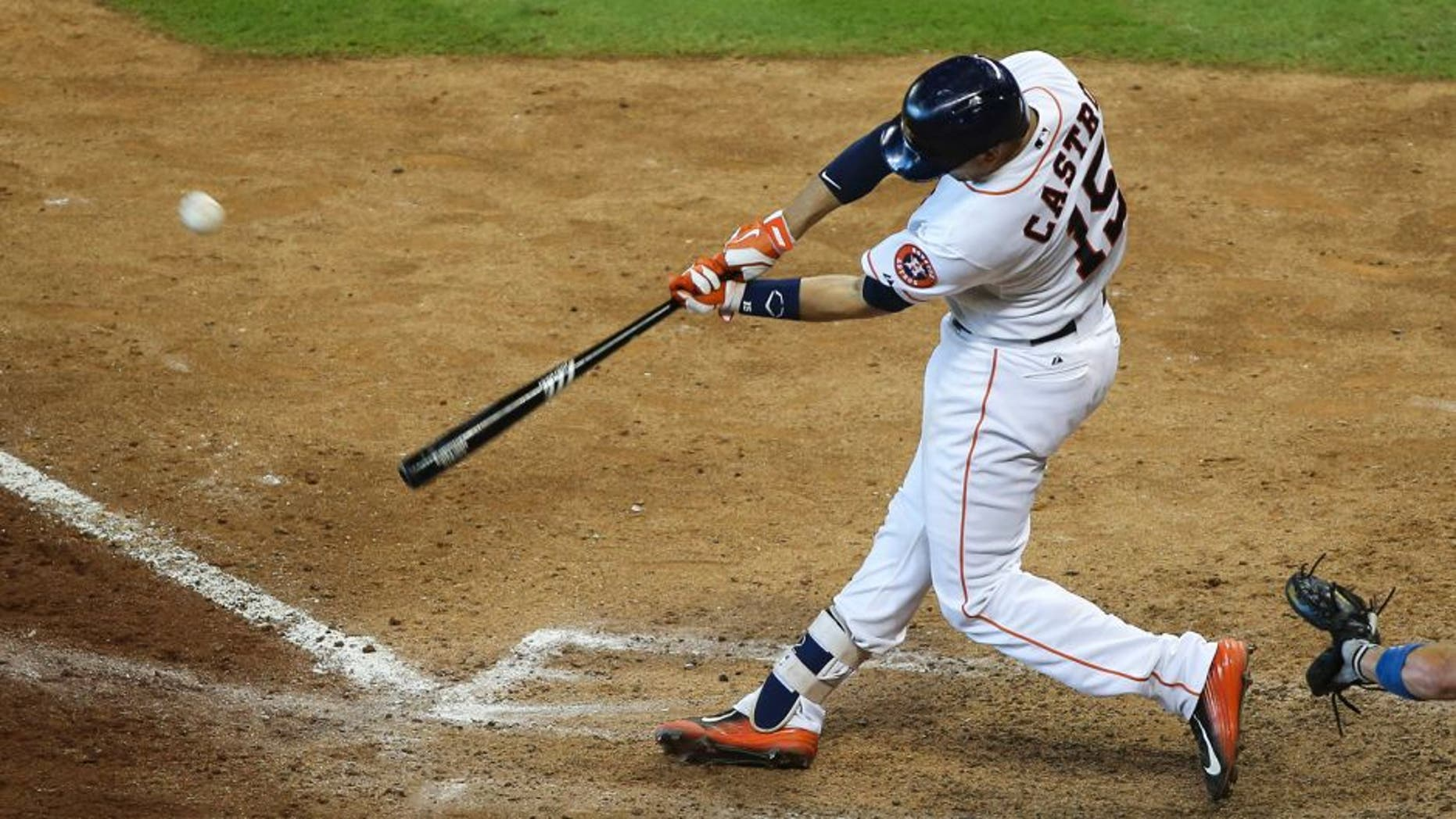 Aug 23, 2015; Houston, TX, USA; Houston Astros catcher Jason Castro (15) hits a game winning walk off home run during the tenth inning against the Los Angeles Dodgers at Minute Maid Park. The Astros defeated the Dodgers 3-2. Mandatory Credit: Troy Taormina-USA TODAY Sports
