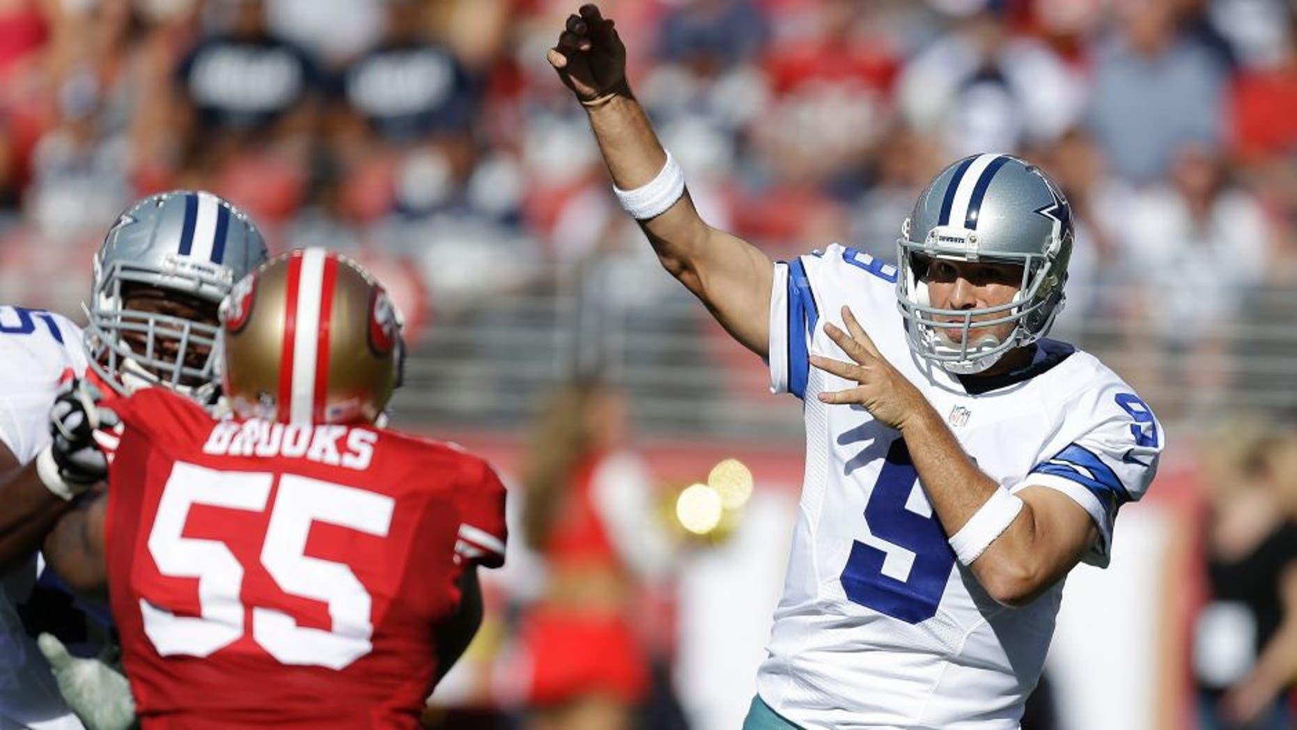 Dallas Cowboys quarterback Tony Romo (9) passes as San Francisco 49ers linebacker Ahmad Brooks (55) applies pressure during the first half of an NFL preseason football game in Santa Clara, Calif., Sunday, Aug. 23, 2015. (AP Photo/Ben Margot)