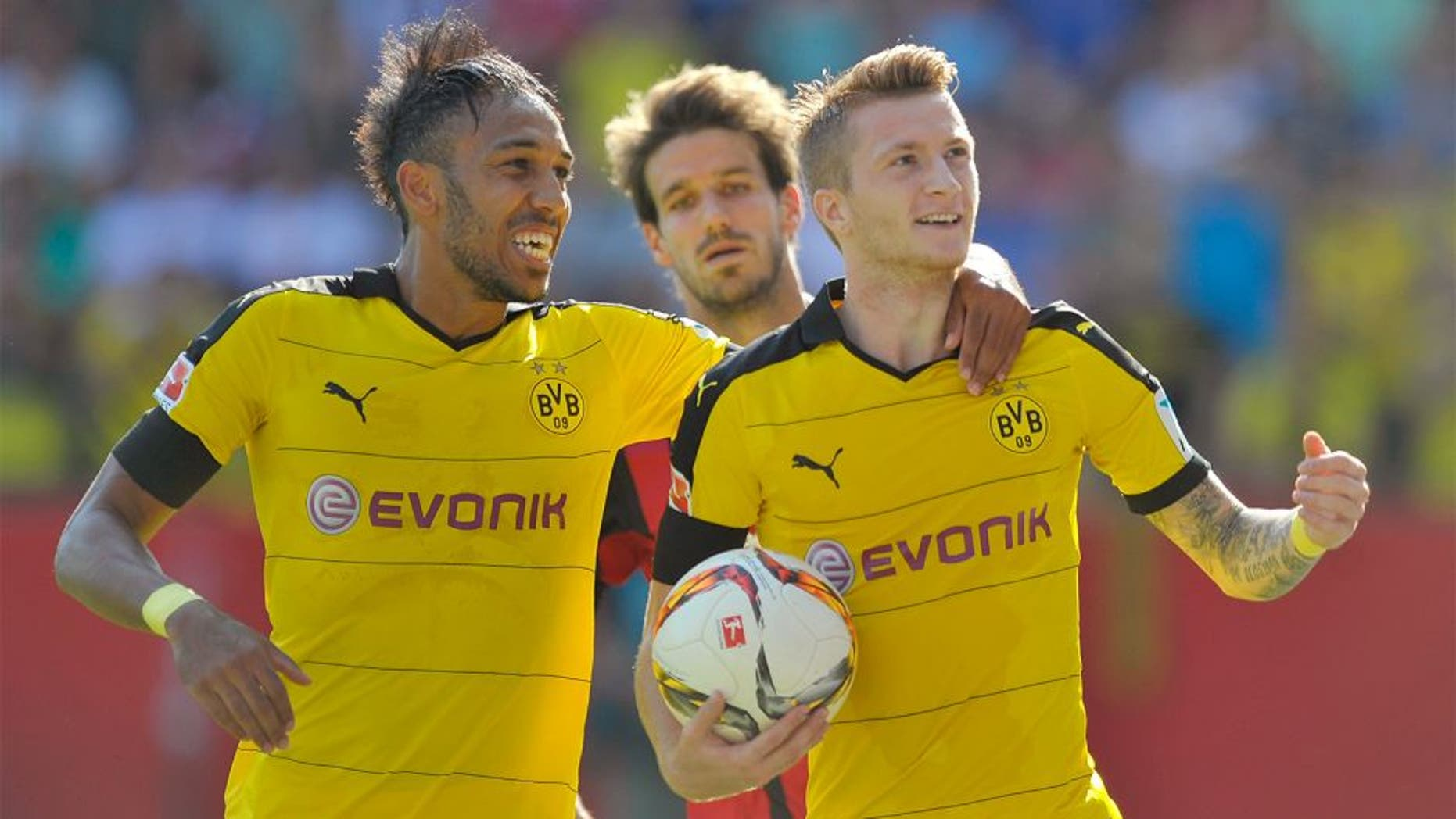 INGOLSTADT, GERMANY - AUGUST 23: Marco Reus (R) and Pierre-Emerick Aubameyang of Borussia Dortmund celebrate their team's second goal during the Bundesliga match between FC Ingolstadt and Borussia Dortmund at Audi Sportpark on August 23, 2015 in Ingolstadt, Germany. (Photo by Lennart Preiss/Bongarts/Getty Images)
