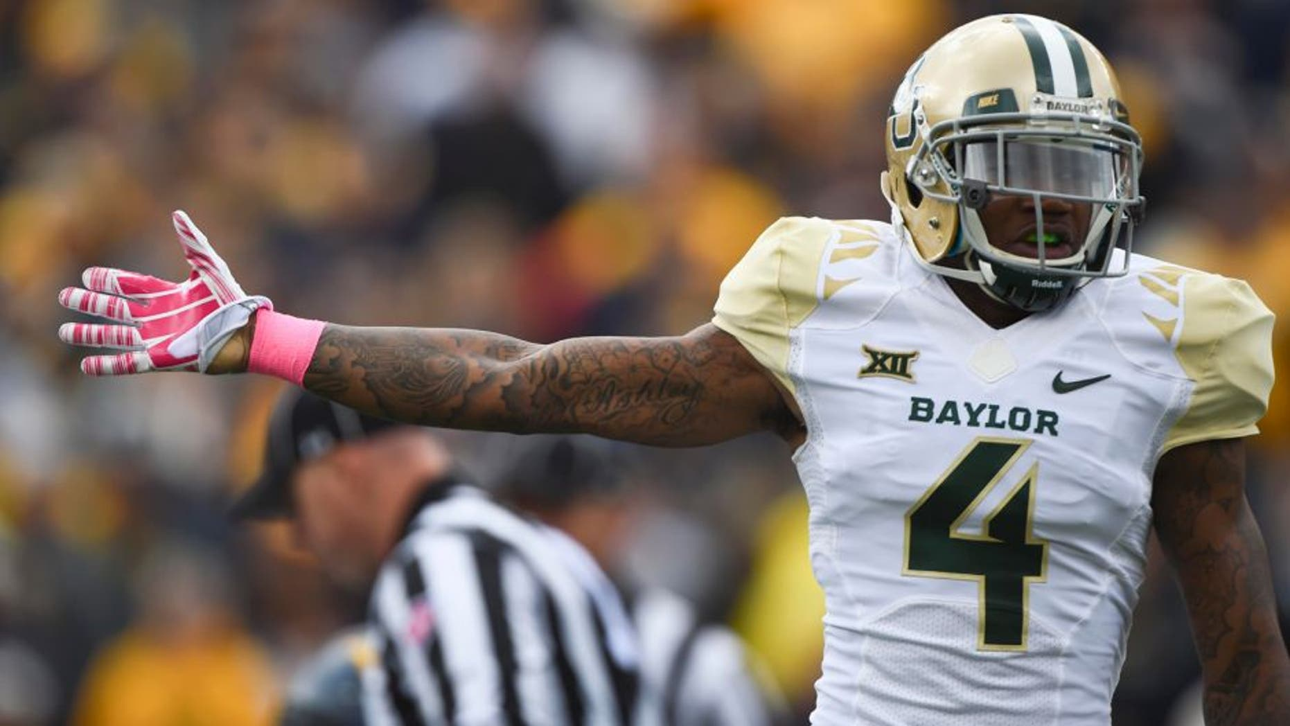 Oct 18, 2014; Morgantown, WV, USA; Baylor Bears cornerback Xavien Howard (4) signals they had recovered the fumble during the first quarter against the West Virginia Mountaineers at Milan Puskar Stadium. Mandatory Credit: Tommy Gilligan-USA TODAY Sports