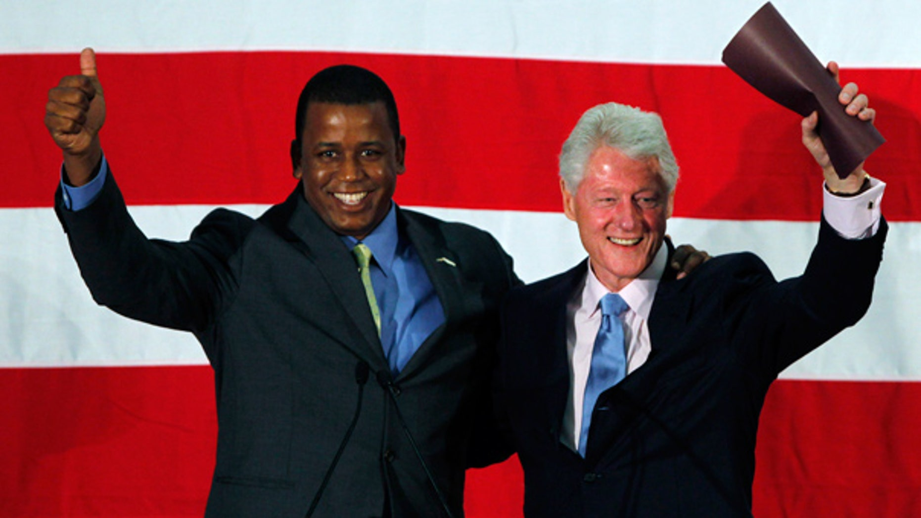 Aug. 16: Rep. Kendrick Meek and Former President Bill Clinton wave as they are introduced during a rally in Davie, Fla.