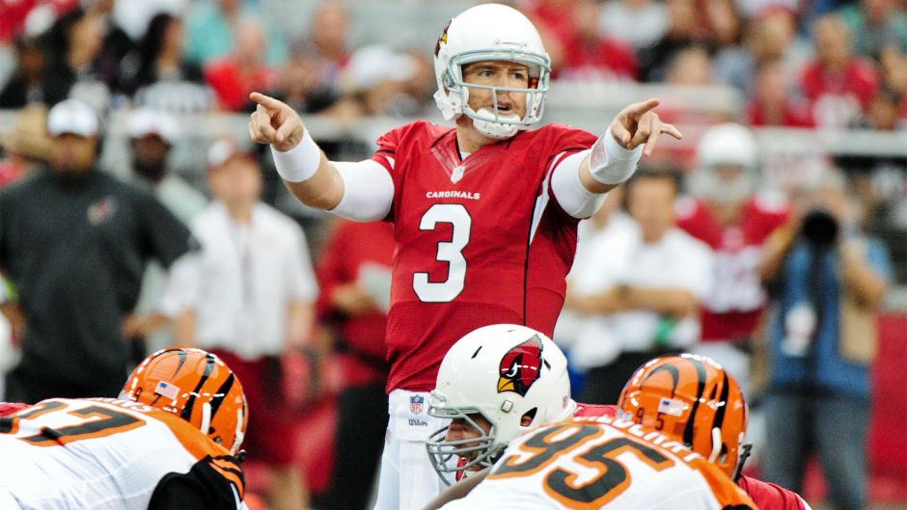 Aug 24, 2014; Glendale, AZ, USA; Arizona Cardinals quarterback Carson Palmer (3) signals to teammates prior to the snap during the first half against the Cincinnati Bengals at University of Phoenix Stadium. Mandatory Credit: Matt Kartozian-USA TODAY Sports