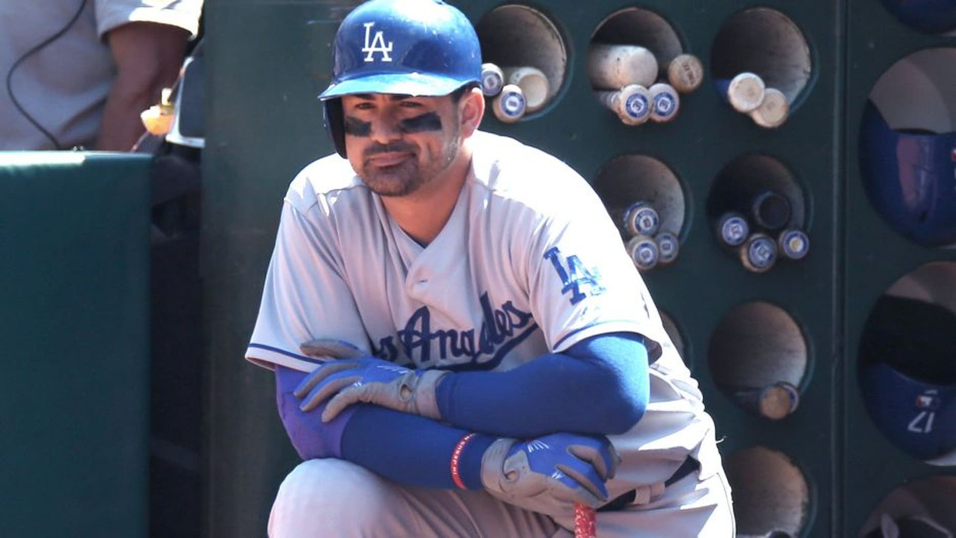 OAKLAND, CA - AUGUST 19: Adrian Gonzalez #23 of the Los Angeles Dodgers waits in the dugout for his next at bat against the Oakland Athletics during the game at O.co Coliseum on Wednesday, August 19, 2015 in Oakland, California. (Photo by Brad Mangin/MLB Photos via Getty Images)