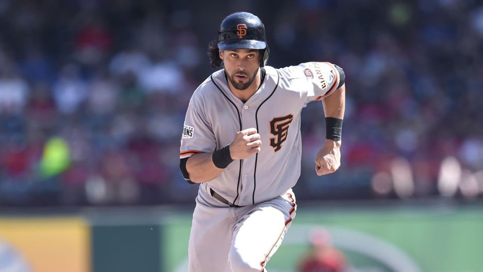 ARLINGTON, TX - AUGUST 02: Angel Pagan #16 of the San Francisco Giants runs the bases as he advances to third base in the game against the Texas Rangers at Globe Life Park in Arlington on August 2, 2015 in Arlington, Texas. The Texas Rangers defeated the San Francisco Giants 2-1. (Photo by John Williamson/MLB Photos via Getty Images)