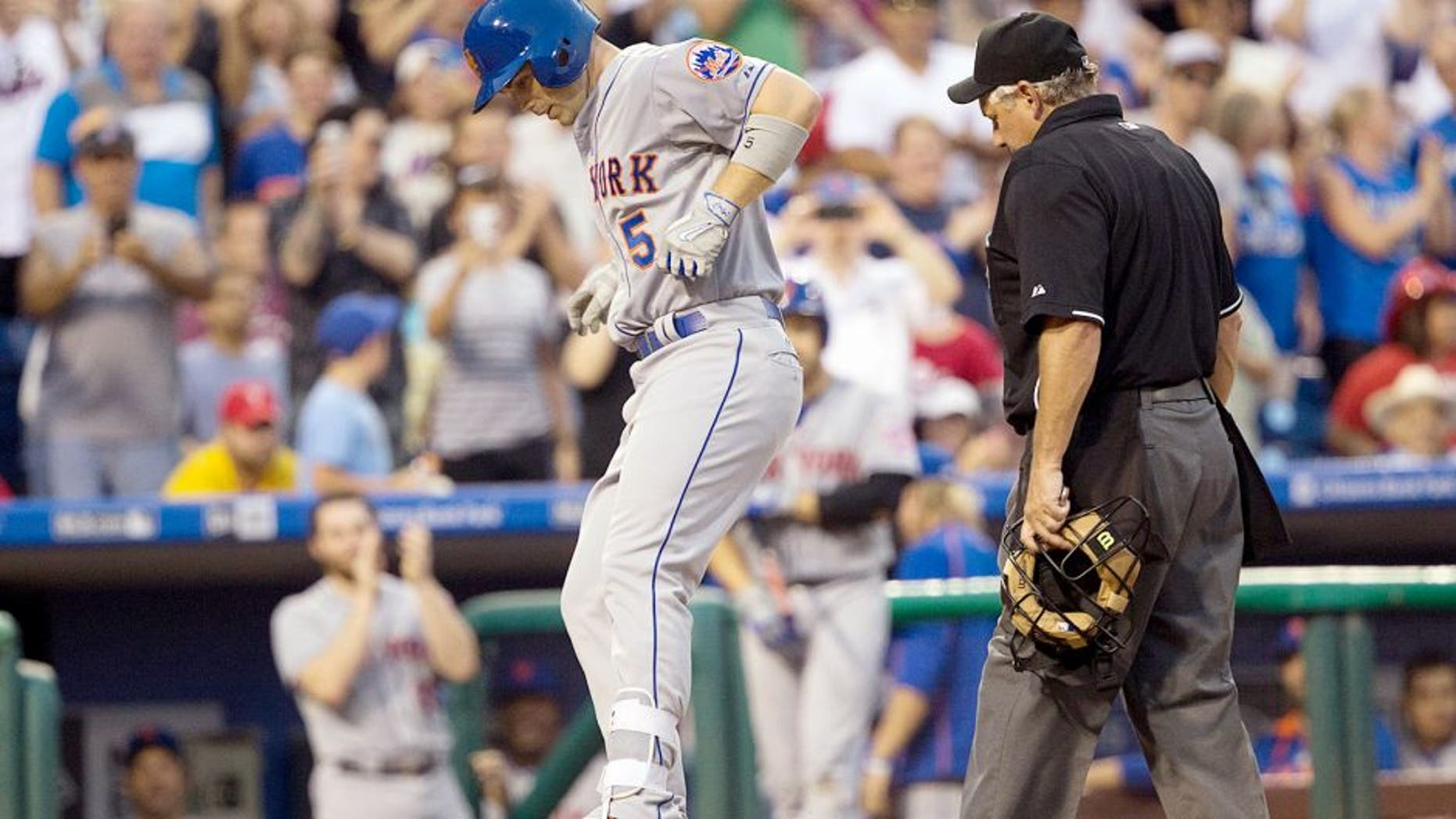 Aug 24, 2015; Philadelphia, PA, USA; New York Mets third baseman David Wright (5) jumps on home plate after hitting a solo home run during the second inning against the Philadelphia Phillies at Citizens Bank Park. Mandatory Credit: Bill Streicher-USA TODAY Sports