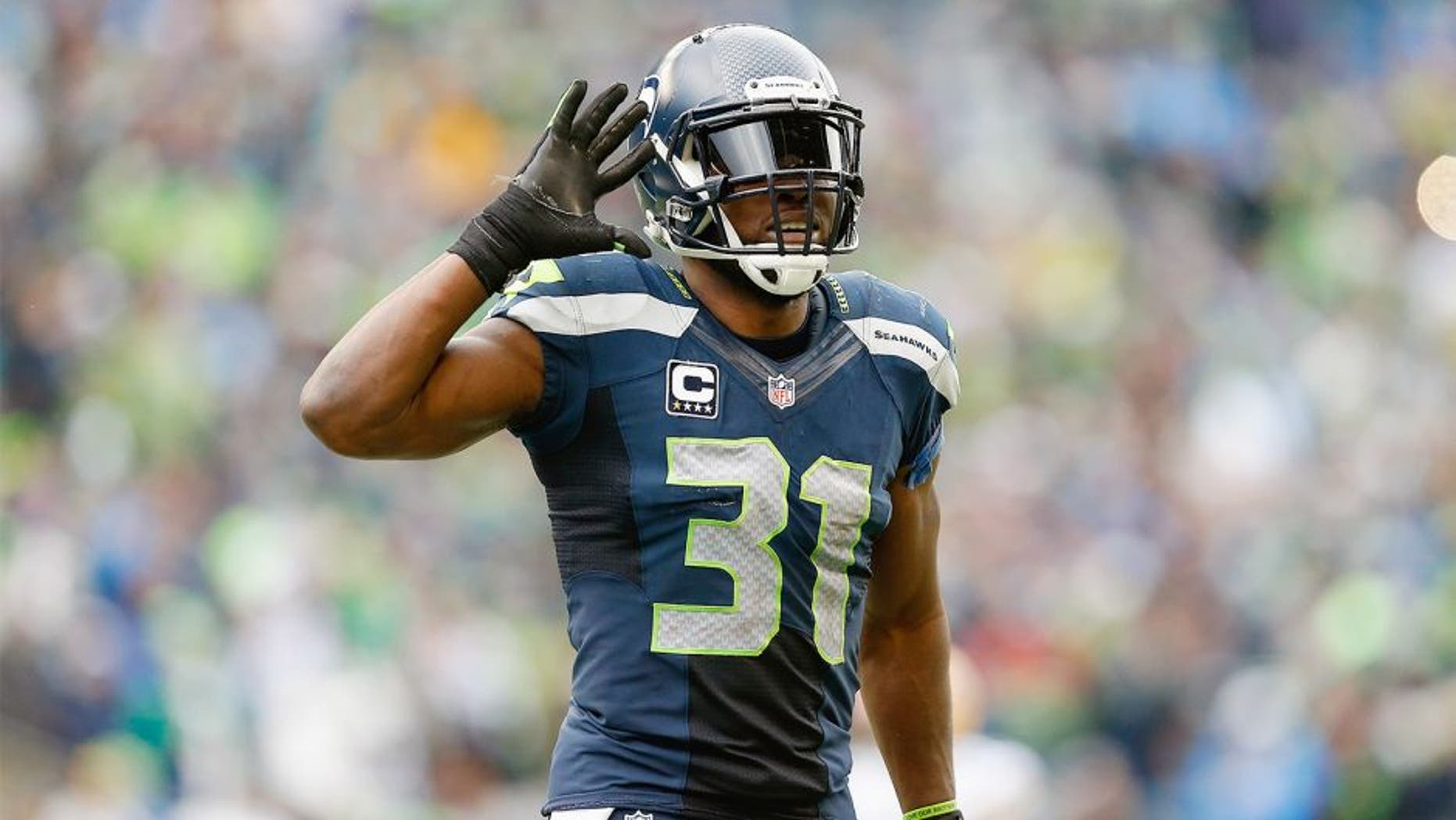SEATTLE, WA - JANUARY 18: Strong safety Kam Chancellor #31 of the Seattle Seahawks reacts in the 2015 NFC Championship game against the Green Bay Packers at CenturyLink Field on January 18, 2015 in Seattle, Washington. The Seahawks defeated the Packers 28-22 in overtime. (Photo by Christian Petersen/Getty Images)
