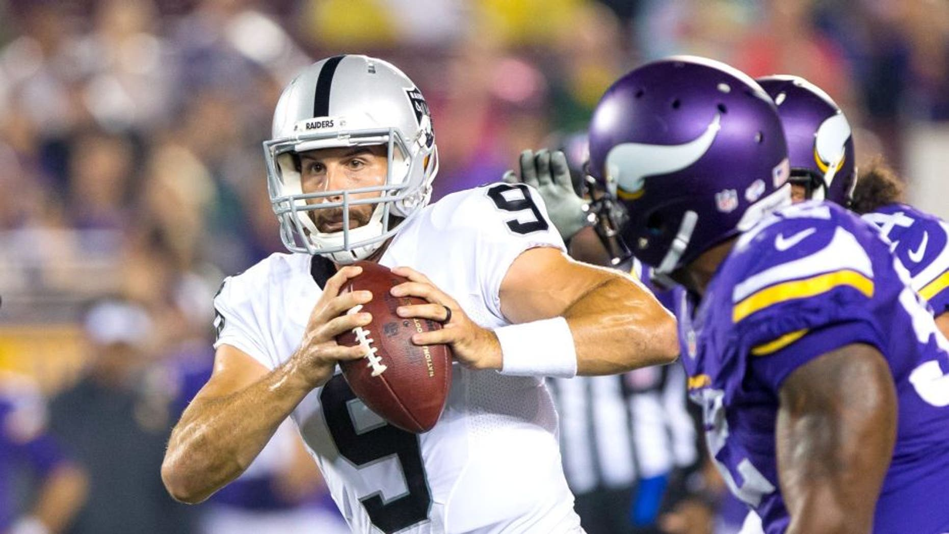 Aug 22, 2015; Minneapolis, MN, USA; Oakland Raiders quarterback Christian Ponder (9) scrambles in the third quarter against the Minnesota Vikings at TCF Bank Stadium. The Minnesota Vikings beat the Oakland Raiders 20-12. Mandatory Credit: Brad Rempel-USA TODAY Sports
