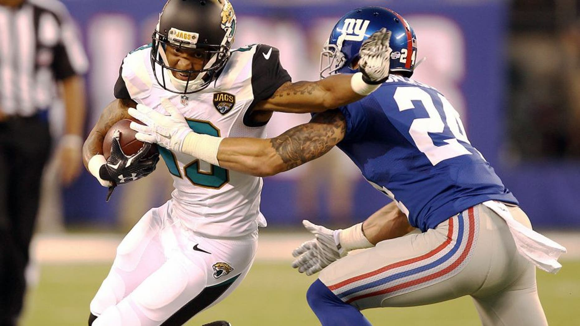 Aug 22, 2015; East Rutherford, NJ, USA; Jacksonville Jaguars wide receiver Rashad Greene (13) catches a ball in front of New York Giants safety Bennett Jackson (24) during the first half at MetLife Stadium. Mandatory Credit: Danny Wild-USA TODAY Sports