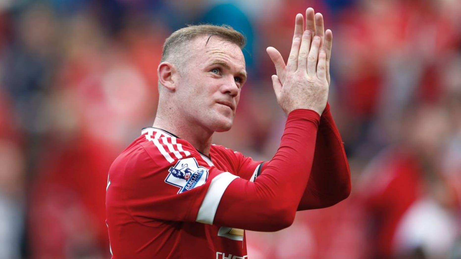 MANCHESTER, ENGLAND - AUGUST 22: Wayne Rooney of Manchester United applauds crowds after his team's 0-0 draw in the Barclays Premier League match between Manchester United and Newcastle United at Old Trafford on August 22, 2015 in Manchester, England. (Photo by Julian Finney/Getty Images)