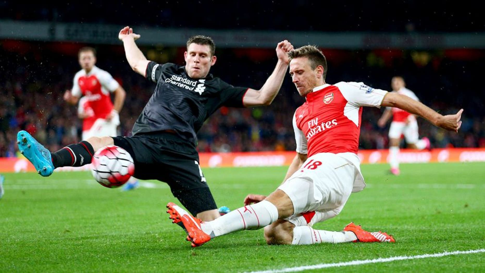LONDON, ENGLAND - AUGUST 24: Nacho Monreal of Arsenal is closed down by James Milner of Liverpool during the Barclays Premier League match between Arsenal and Liverpool at Emirates Stadium on August 24, 2015 in London, England. (Photo by Clive Mason/Getty Images)
