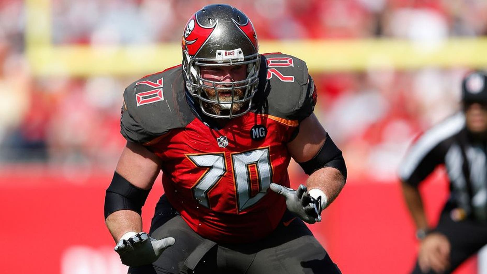 TAMPA, FL - DECEMBER 28: Logan Mankins #70 of the Tampa Bay Buccaneers blocks against the New Orleans Saints during the game at Raymond James Stadium on December 28, 2014 in Tampa, Florida. The Saints defeated the Bucs 23-20. (Photo by Joe Robbins/Getty Images)