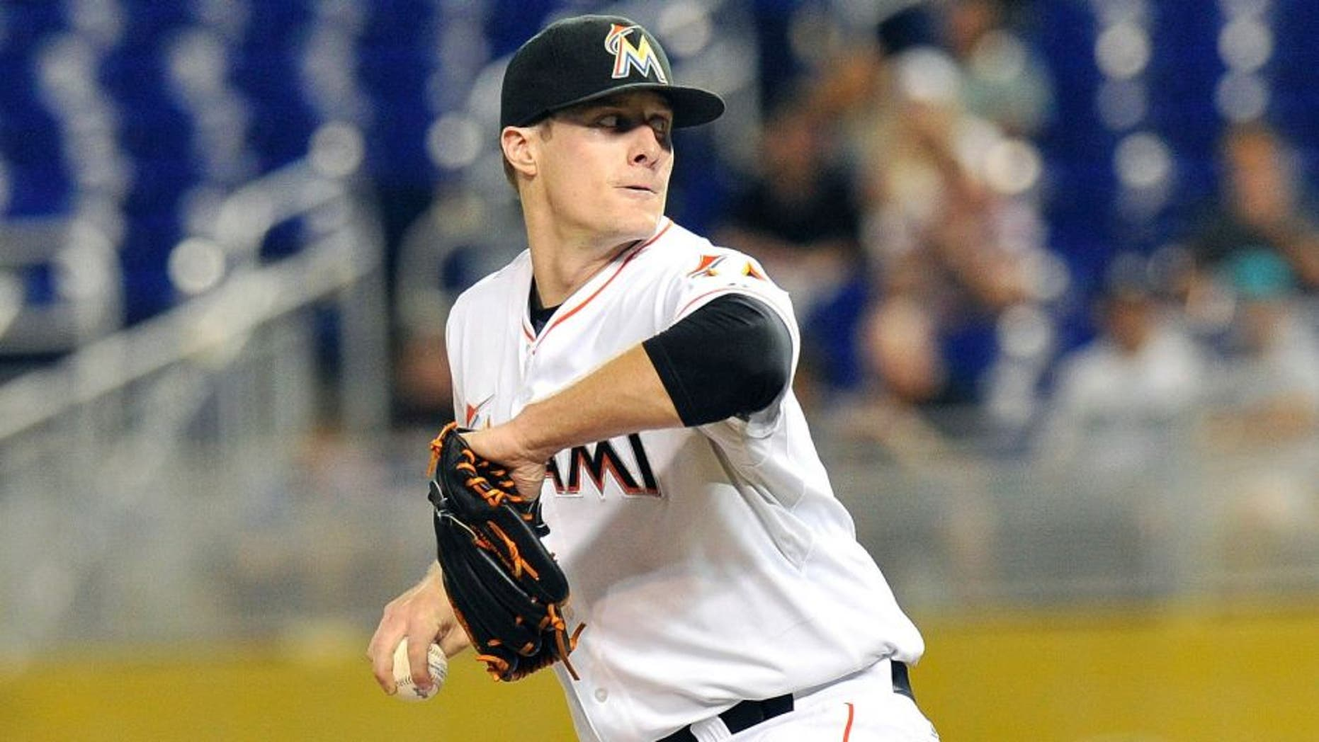 Aug 24, 2015; Miami, FL, USA; Miami Marlins starting pitcher Tom Koehler (34) delivers a pitch against the Pittsburgh Pirates during the first inning at Marlins Park. Mandatory Credit: Steve Mitchell-USA TODAY Sports