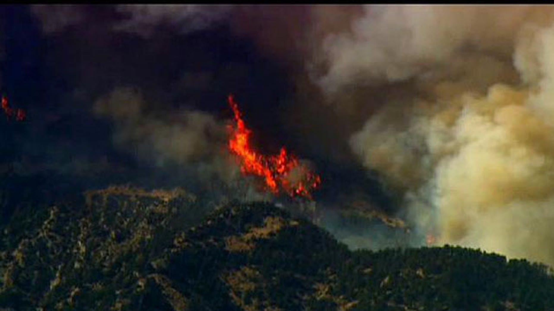 A wind-whipped wildfire burned through 11 homes outside an Oregon college town as hot, dry weather -- with temperatures near 100 degrees -- also helped fires spread in Idaho and Southern California, where homes were evacuated (FNC).