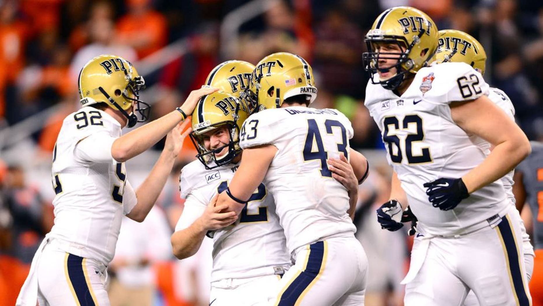 Dec 26, 2013; Detroit, MI, USA; Pittsburgh Panthers kicker Chris Blewitt (12) celebrates with teammates after kicking a field goal during the fourth quarter of the Little Caesars Pizza Bowl against the Bowling Green Falcons at Ford Field. Pittsburgh Panthers defeated Bowling Green Falcons 30-27. Mandatory Credit: Andrew Weber-USA TODAY Sports