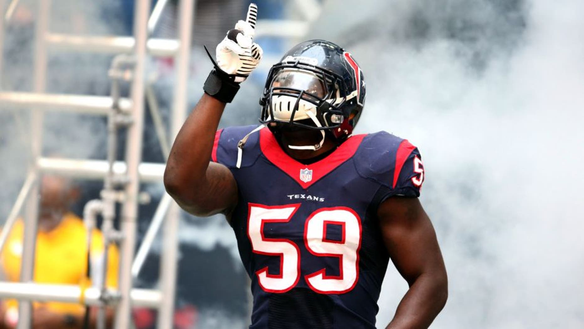 Dec 1, 2013; Houston, TX, USA; Houston Texans linebacker Whitney Mercilus (59) points as he is introduced prior to the game against the New England Patriots at Reliant Stadium. Mandatory Credit: Matthew Emmons-USA TODAY Sports