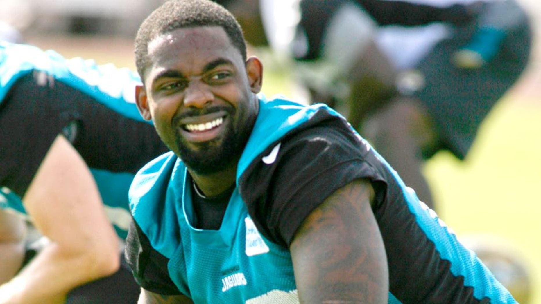May 28, 2015; Jacksonville, FL, USA; Jacksonville Jaguars wide receiver Arrelious Benn (12) smiles as he stretches during OTAs at the Florida Blue Health and Wellness Practice Fields. Mandatory Credit: Phil Sears-USA TODAY Sports