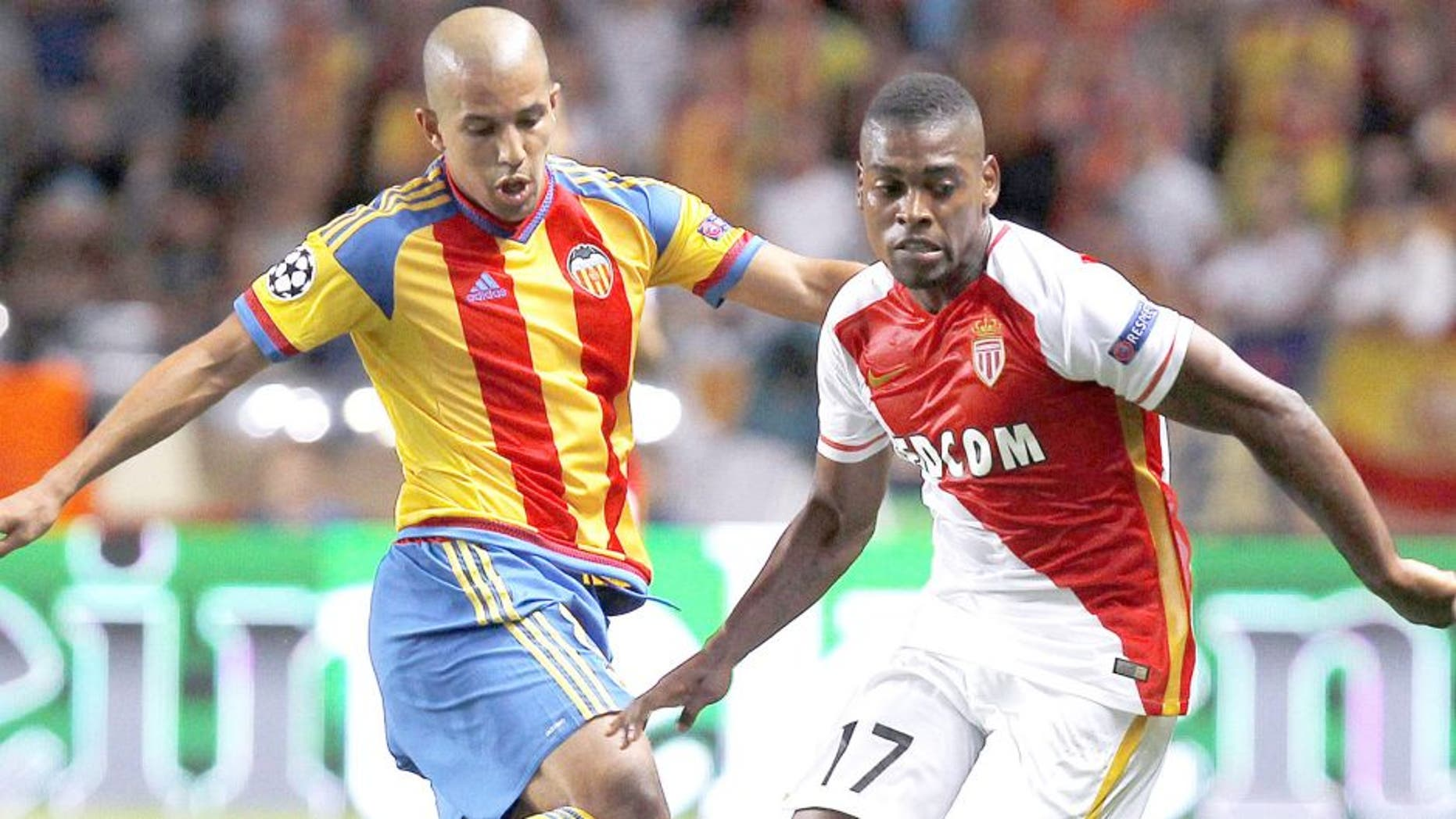 Valencia's French midfielder Sofiane Feghouli (L) vies with Monaco's Portuguese forward Ivan Cavaleiro (R) during the UEFA Champions League playoff football match between AS Monaco FC vs Valencia CF, at the Louis II Stadium, in Monaco, on August 25, 2015 . AFP PHOTO / JEAN CHRISTOPHE MAGNENET (Photo credit should read JEAN CHRISTOPHE MAGNENET/AFP/Getty Images)