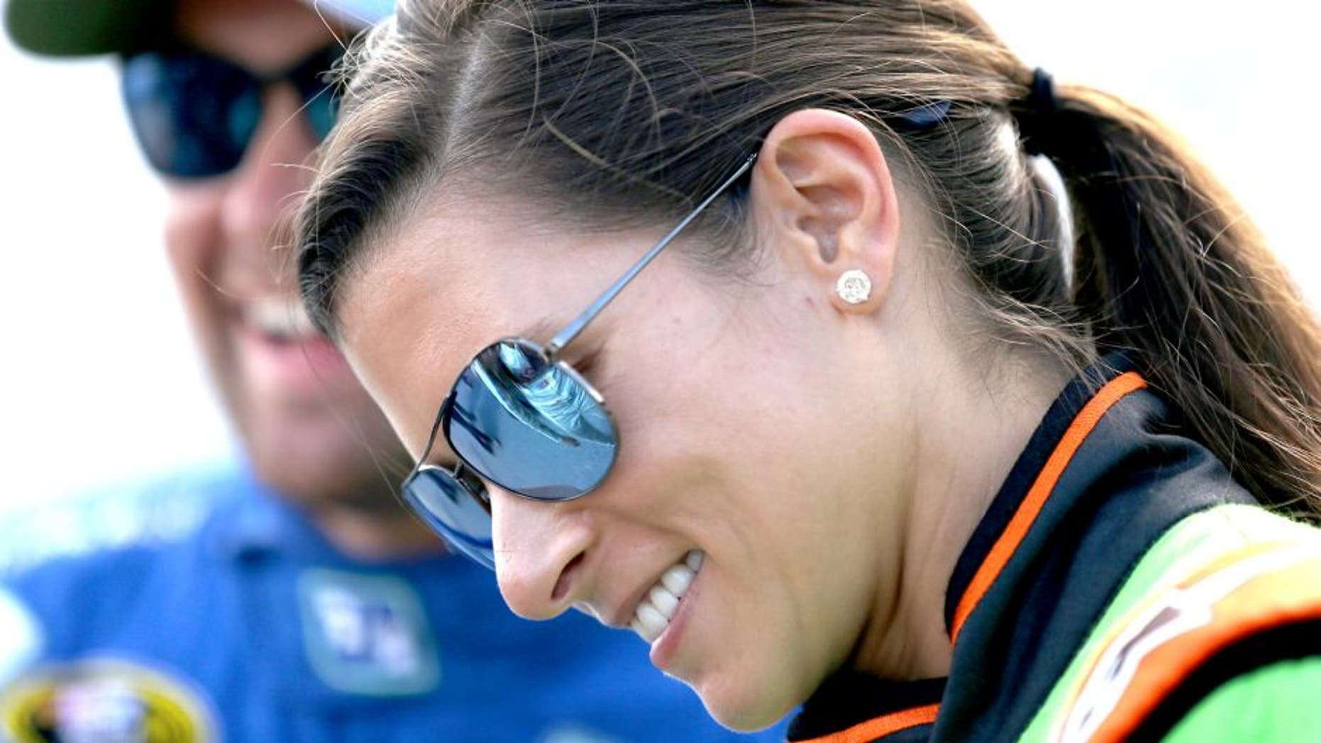 DAYTONA BEACH, FL - JULY 04: Danica Patrick, driver of the #10 GoDaddy Chevrolet, speaks with Ricky Stenhouse Jr., driver of the #17 Fifth Third Bank Ford, during qualifying for the NASCAR Sprint Cup Series Coke Zero 400 at Daytona International Speedway on July 4, 2015 in Daytona Beach, Florida. (Photo by Patrick Smith/Getty Images)