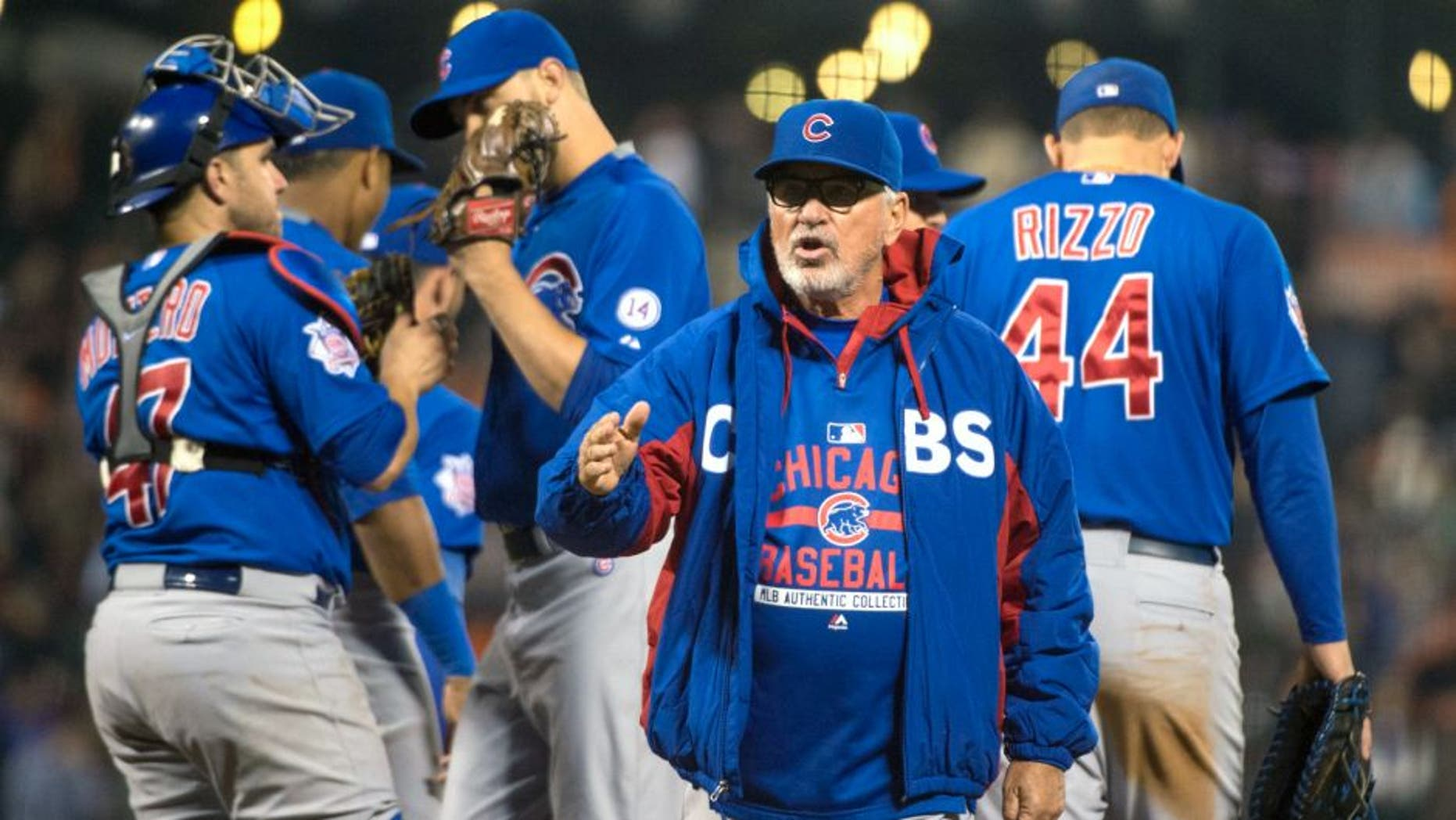 August 25, 2015; San Francisco, CA, USA; Chicago Cubs manager Joe Maddon (70) completes a pitching change during the seventh inning against the San Francisco Giants at AT&T Park. Mandatory Credit: Kyle Terada-USA TODAY Sports