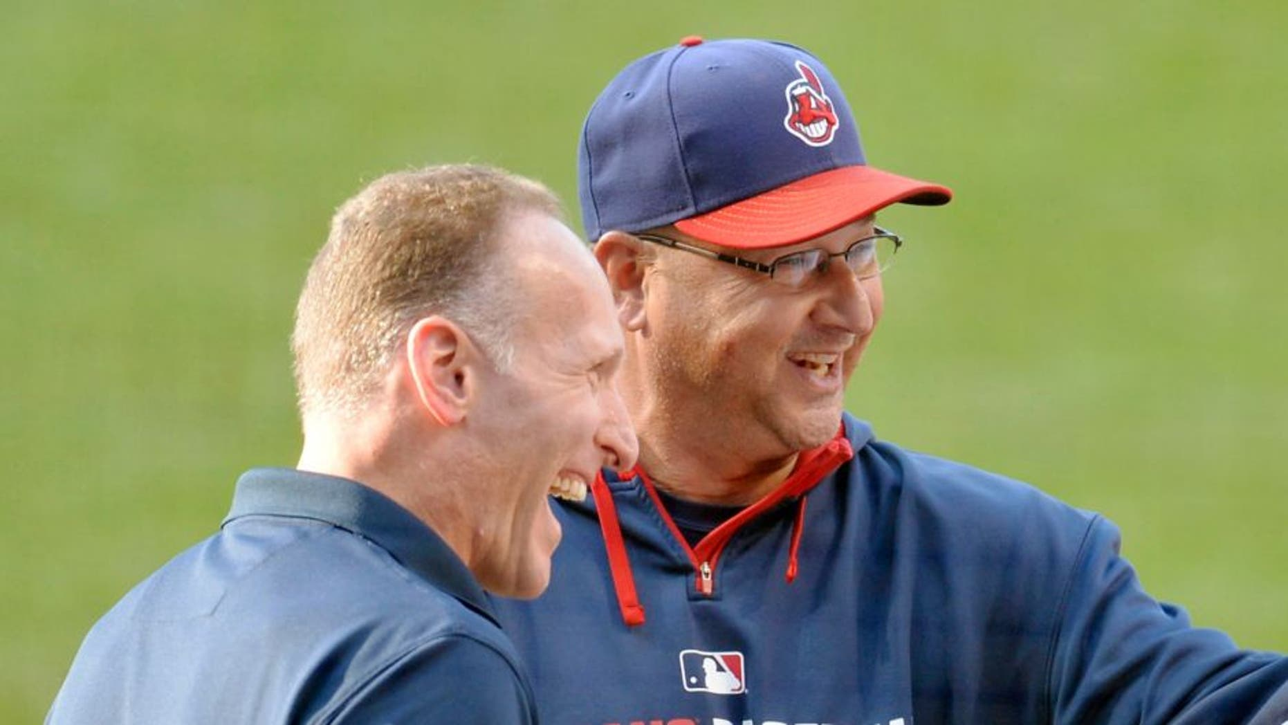Jul 10, 2014; Cleveland, OH, USA; New York Yankees shortstop Derek Jeter (2) talks with Cleveland Indians president Mark Shapiro (left), manager Terry Francona (second from left) and designated hitter Jason Giambi (25) during a pre-game ceremony honoring Jeter at Progressive Field. Mandatory Credit: David Richard-USA TODAY Sports