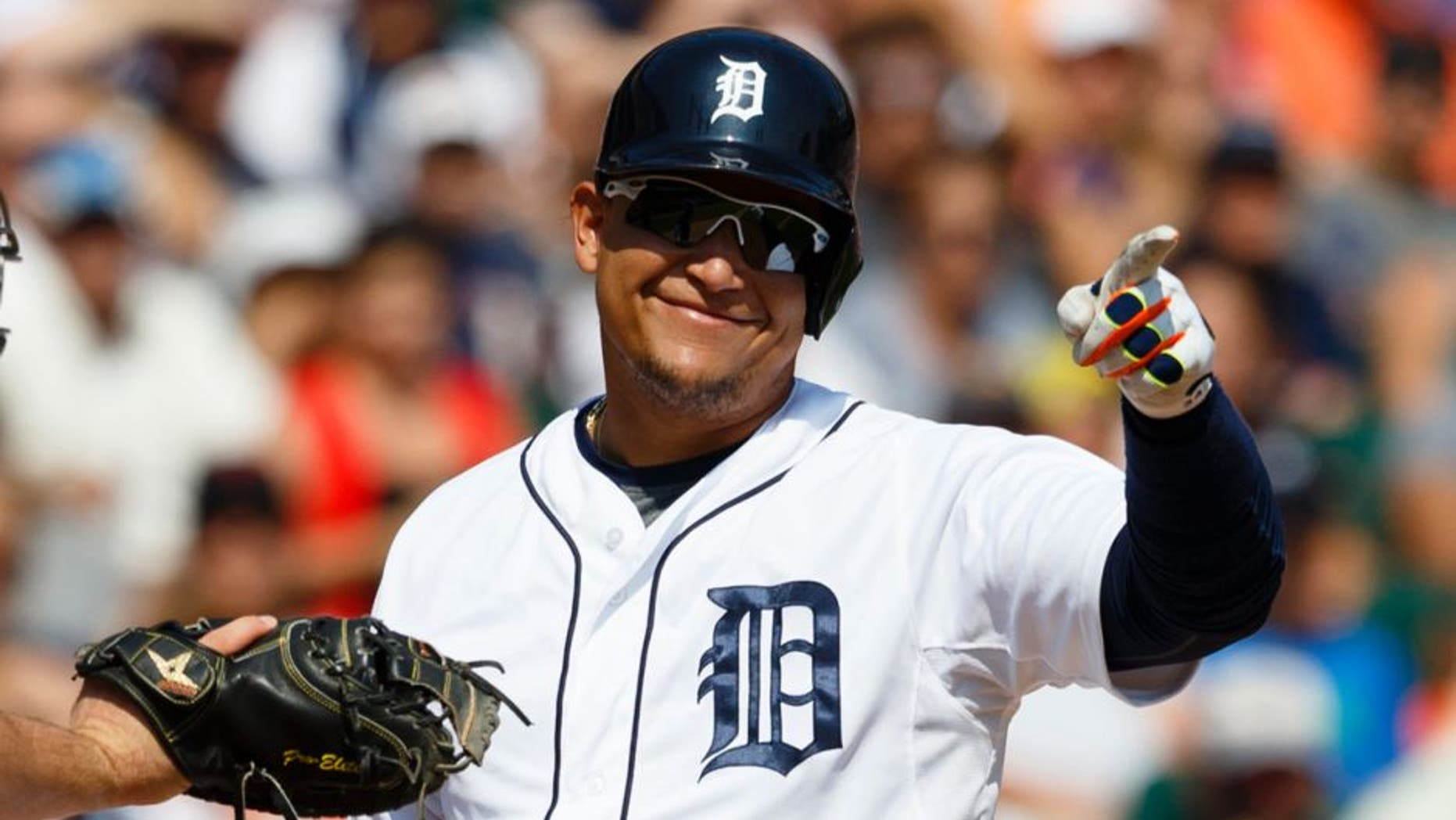 Aug 23, 2015; Detroit, MI, USA; Detroit Tigers designated hitter Miguel Cabrera (24) reacts to a called swing by first base umpire Ron Kulpa (not pictured) as Texas Rangers catcher Chris Gimenez (38) tags him in the seventh inning at Comerica Park. Mandatory Credit: Rick Osentoski-USA TODAY Sports