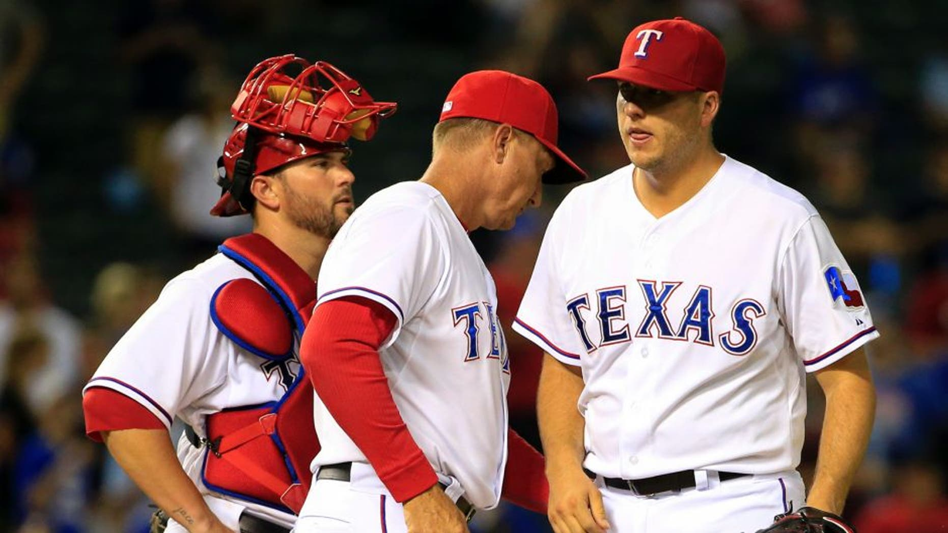 Aug 25, 2015; Arlington, TX, USA; Texas Rangers manager Jeff Banister (middle) takes out relief pitcher Shawn Tolleson (37) during the ninth inning against the Toronto Blue Jays at Globe Life Park in Arlington. Mandatory Credit: Kevin Jairaj-USA TODAY Sports