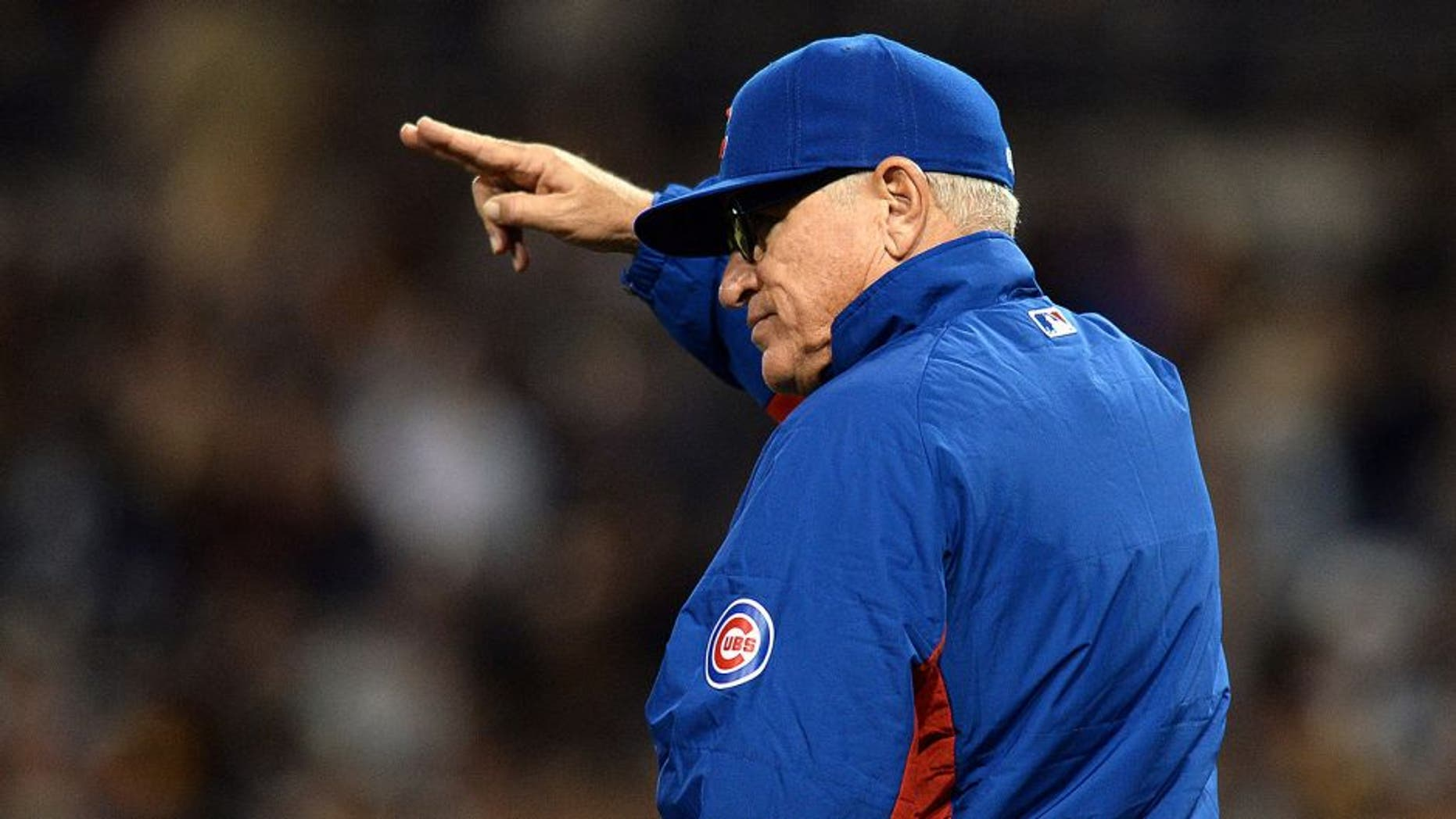 May 20, 2015; San Diego, CA, USA; Chicago Cubs manager Joe Maddon (70) gestures to the bullpen in the seventh inning against the San Diego Padres at Petco Park. Mandatory Credit: Jake Roth-USA TODAY Sports