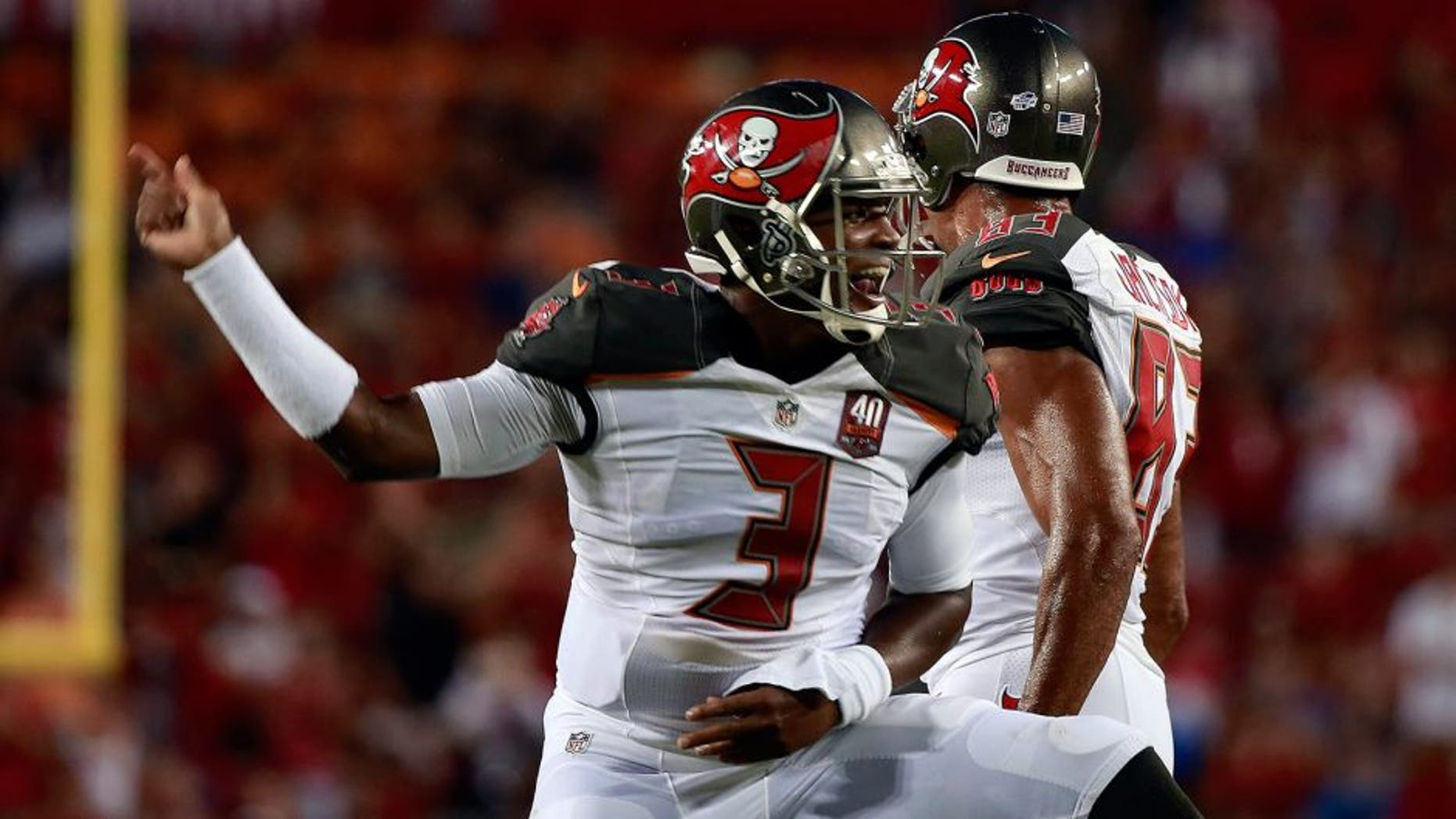Aug 24, 2015; Tampa, FL, USA; Tampa Bay Buccaneers quarterback Jameis Winston (3) celebrates after he scored a touchdown against the Cincinnati Bengals during the first quarter at Raymond James Stadium. Mandatory Credit: Kim Klement-USA TODAY Sports