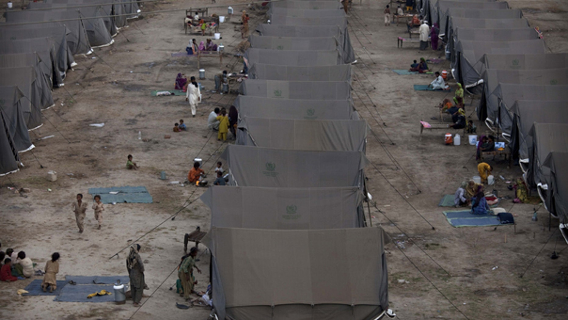 Aug. 26: Pakistanis displaced by flooding sit outside tents at a temporary camp operated by the Army in southern Pakistan.