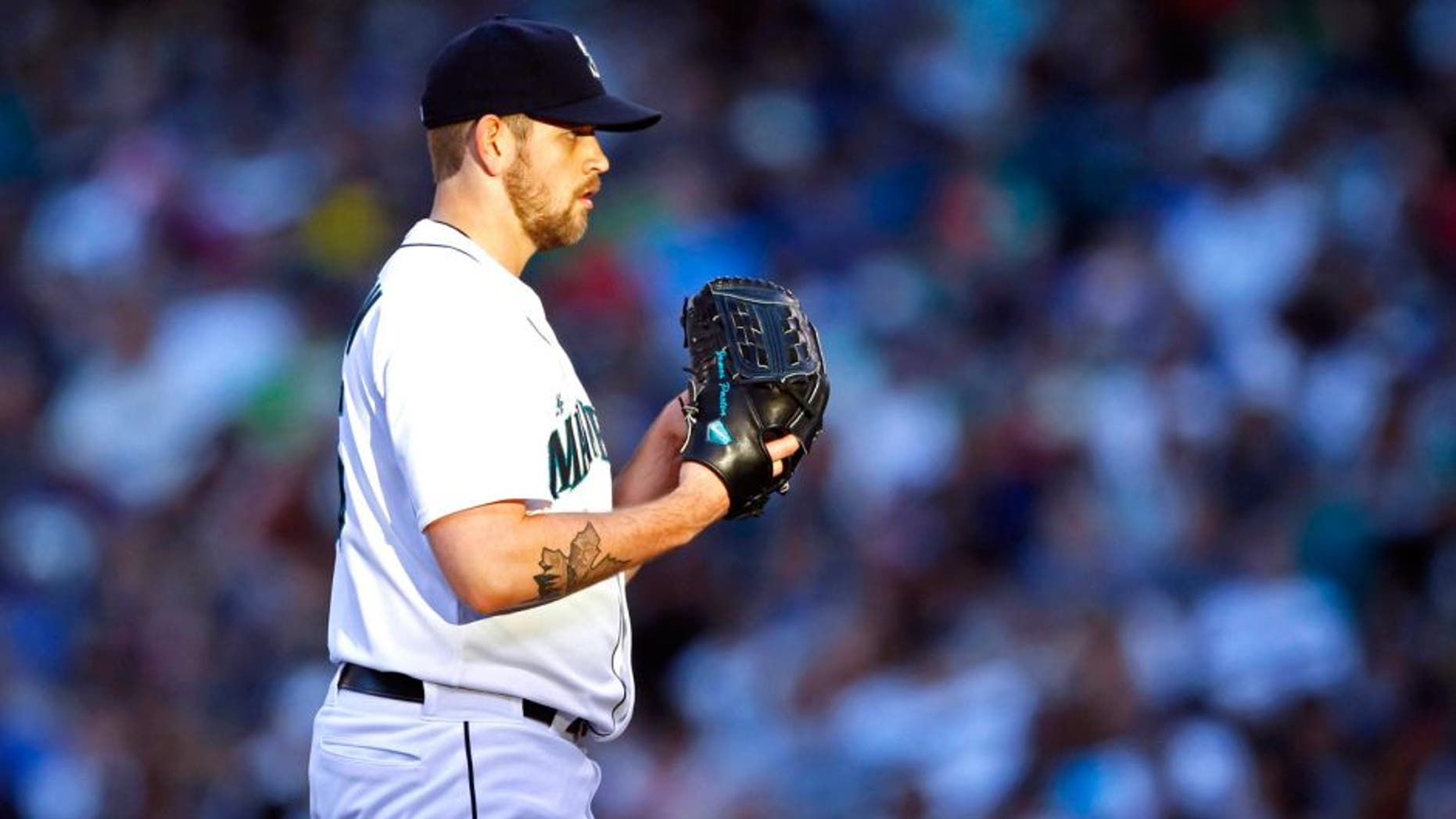 Aug 9, 2014; Seattle, WA, USA; Seattle Mariners pitcher James Paxton (65) stands on the mound against the Chicago White Sox during the sixth inning at Safeco Field. Mandatory Credit: Joe Nicholson-USA TODAY Sports